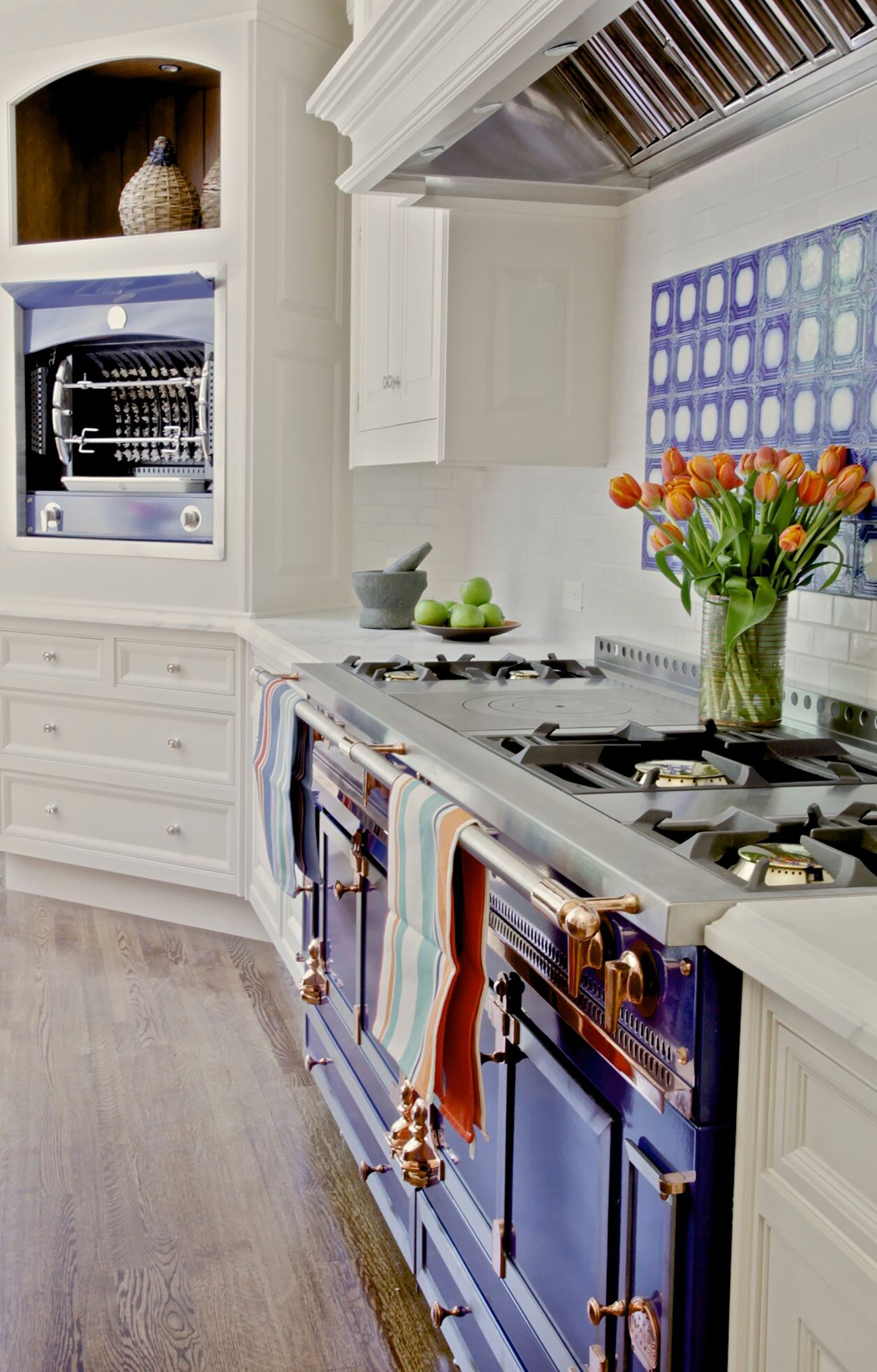 Updated traditional kitchen with indigo range and handmade backsplash tile by bd home