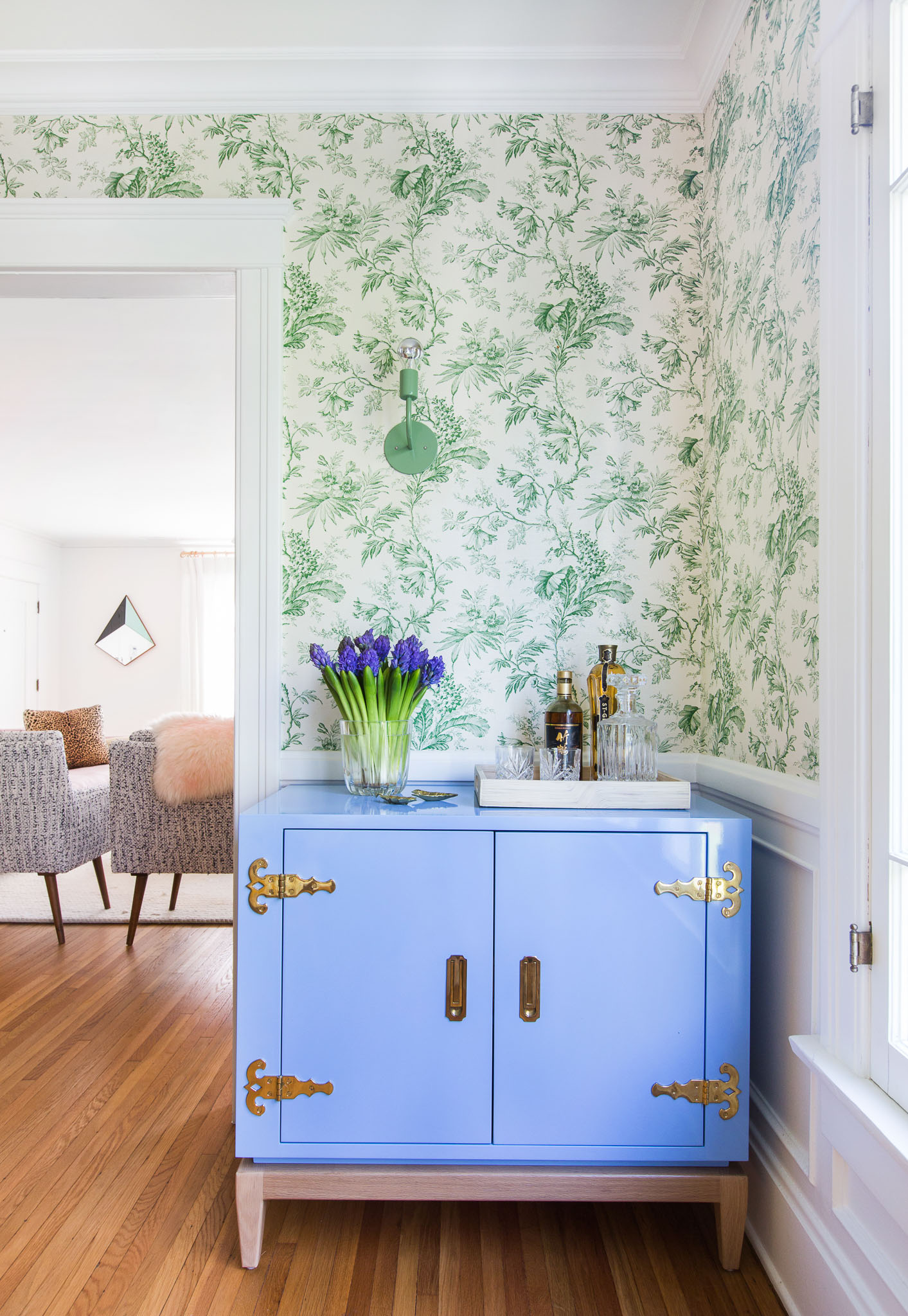Lacquered Bar Cabinet & Vibrant Green Wallcovering in Colorful California Home by Stefani Stein Inc.