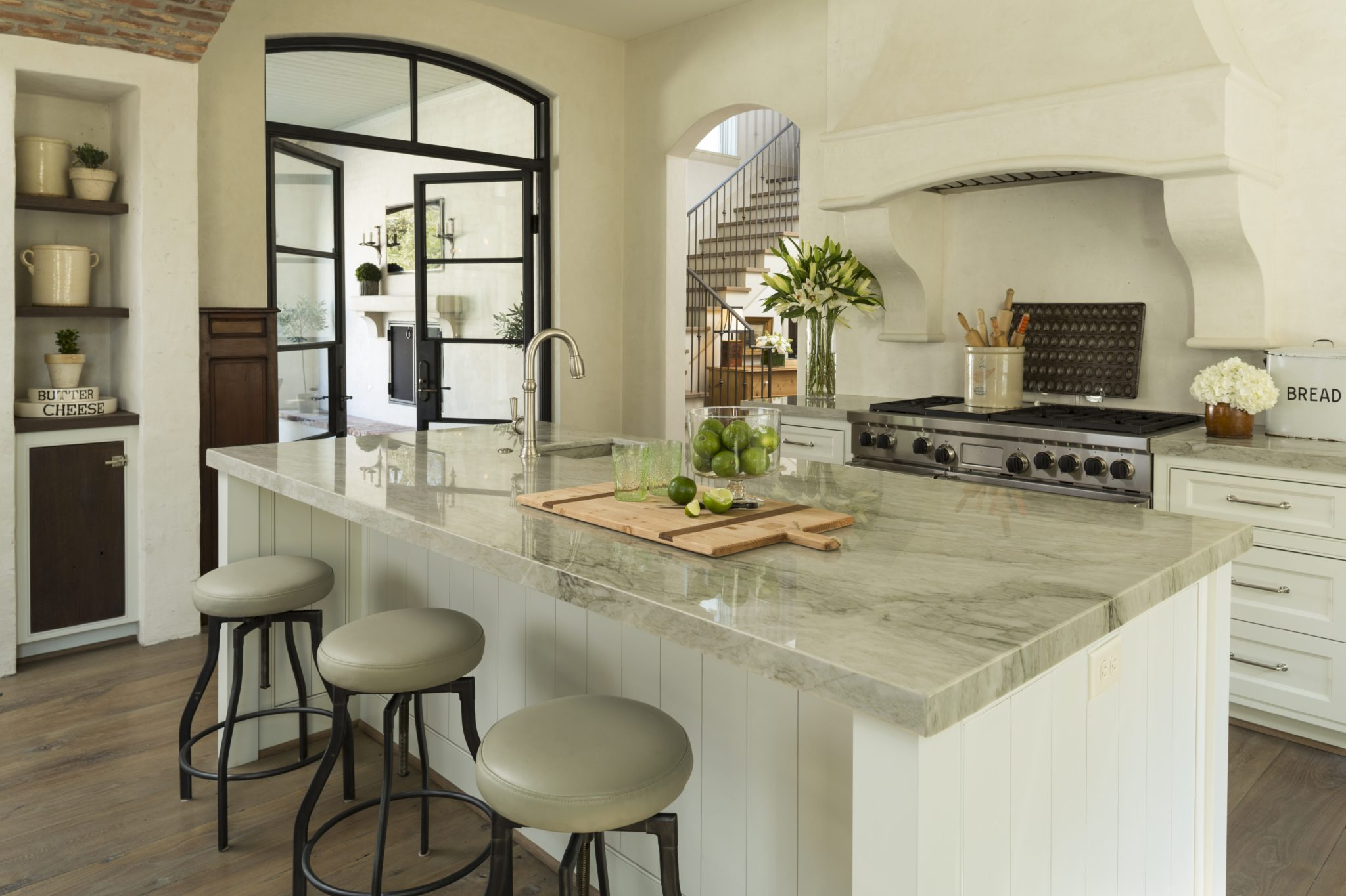 West University, Houston, kitchen with stone architectural details by Chapman Design