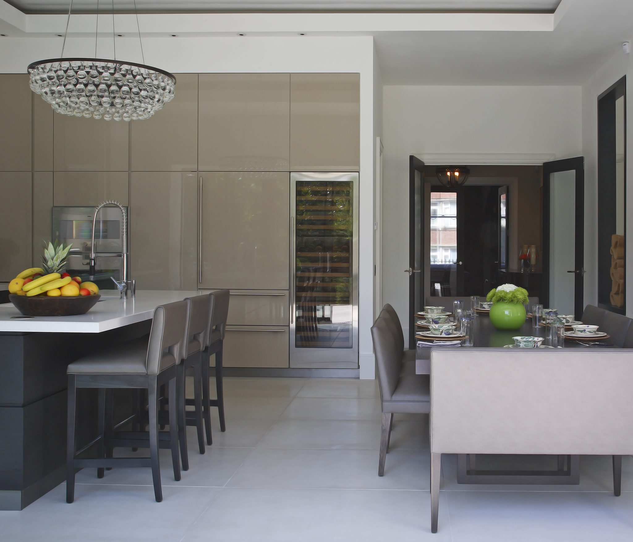 Open plan living using lacquer, smoked oak and concrete by dk INTERIORS