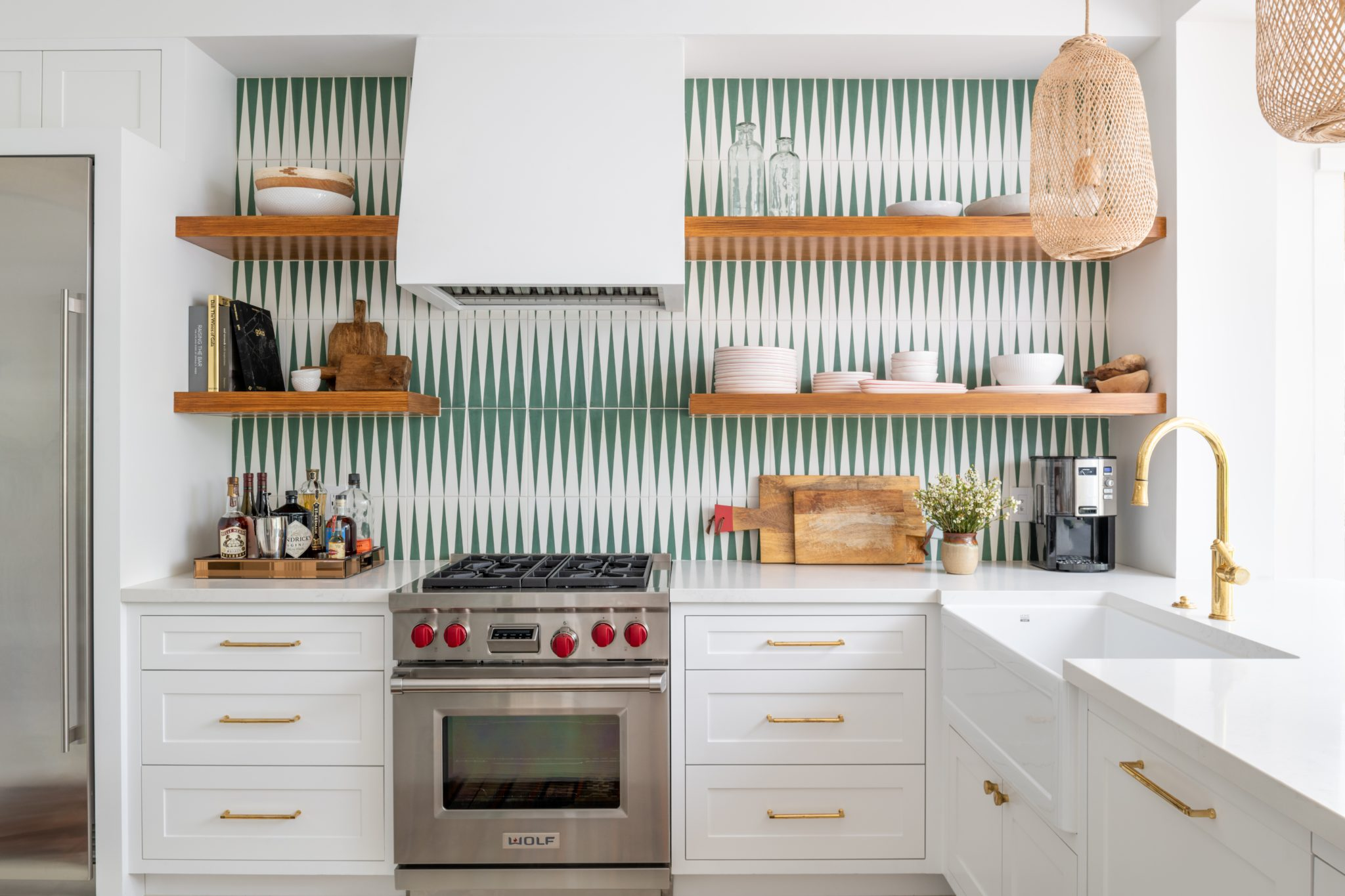 A Bright Kitchen with Open Shelving and Green Patterned Tiles by Maureen Stevens Design
