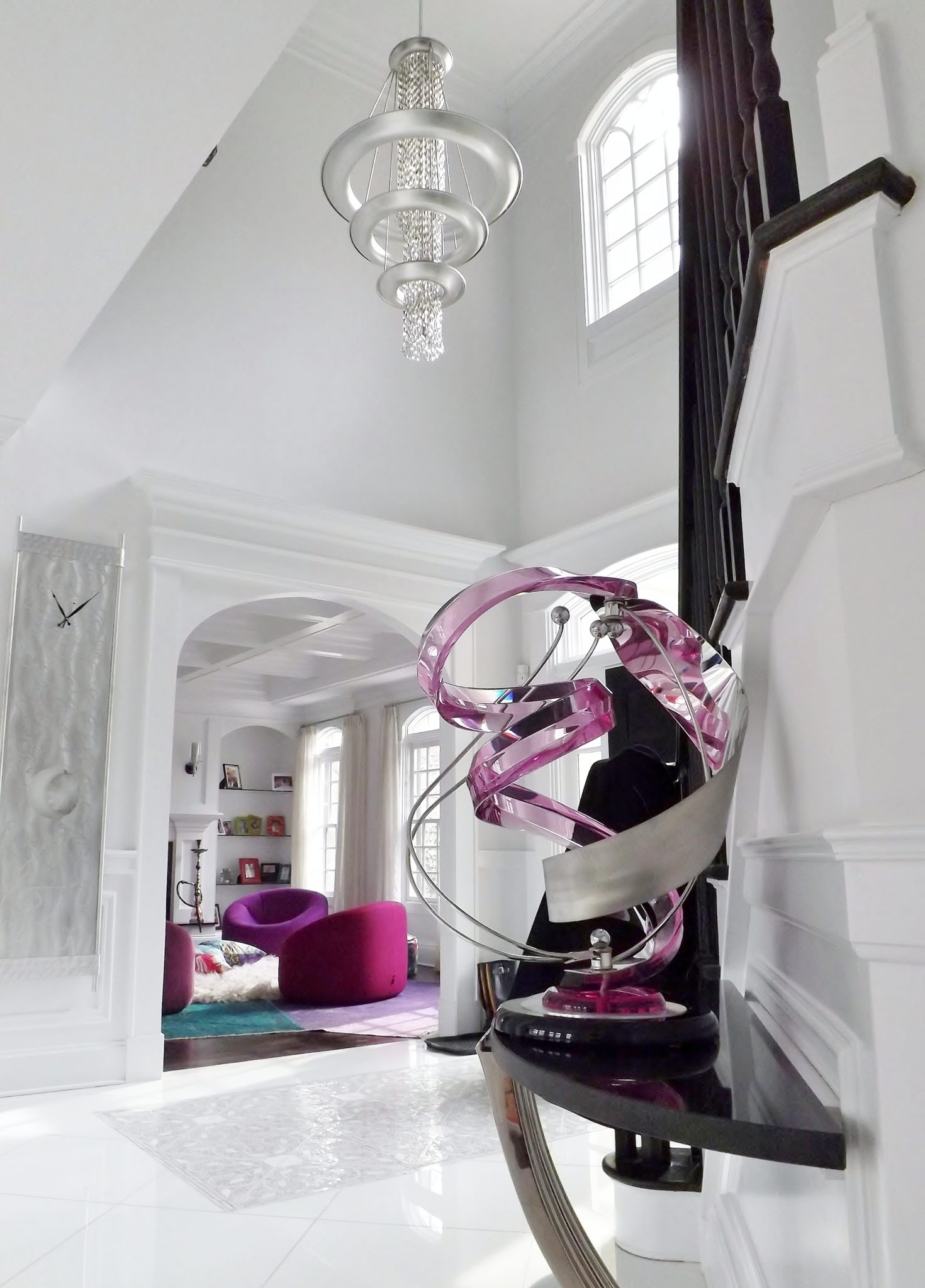 Contemporary foyer white with a splash of magenta by Mark P. Finlay Interiors