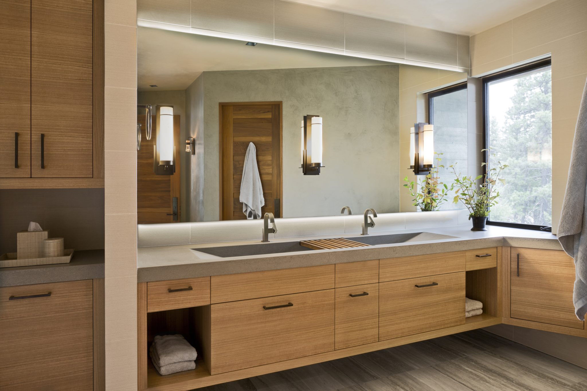 Concrete trough sink functions for a family bathroom in avacation home. By Brown Design Group