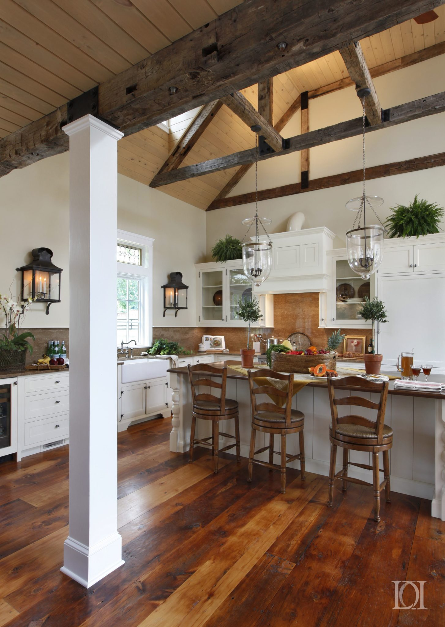 Renovated farmhouse kitchen with white cabinets and mahogany island top by Deborah Leamann Interior Design
