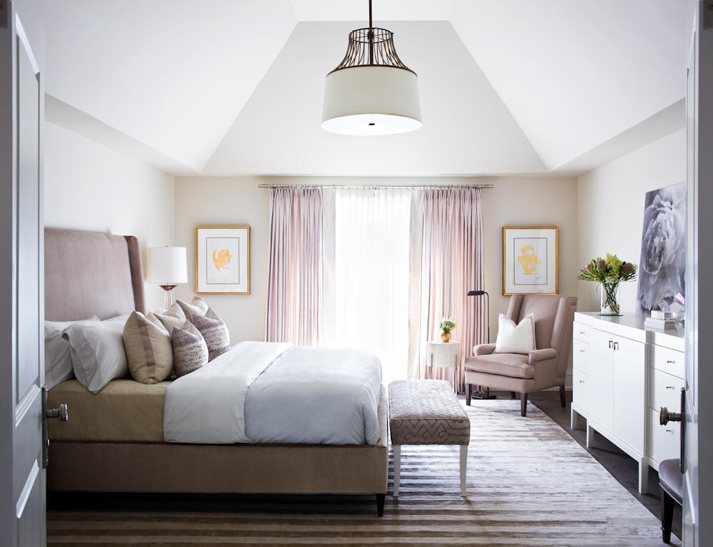 The master suite is beautifully layered with a hanging pendant by Baker, a silk-velvet upholstered bed frame by Hickory Chair, and an ivory lacquered dresser by Powell & Bonnell.