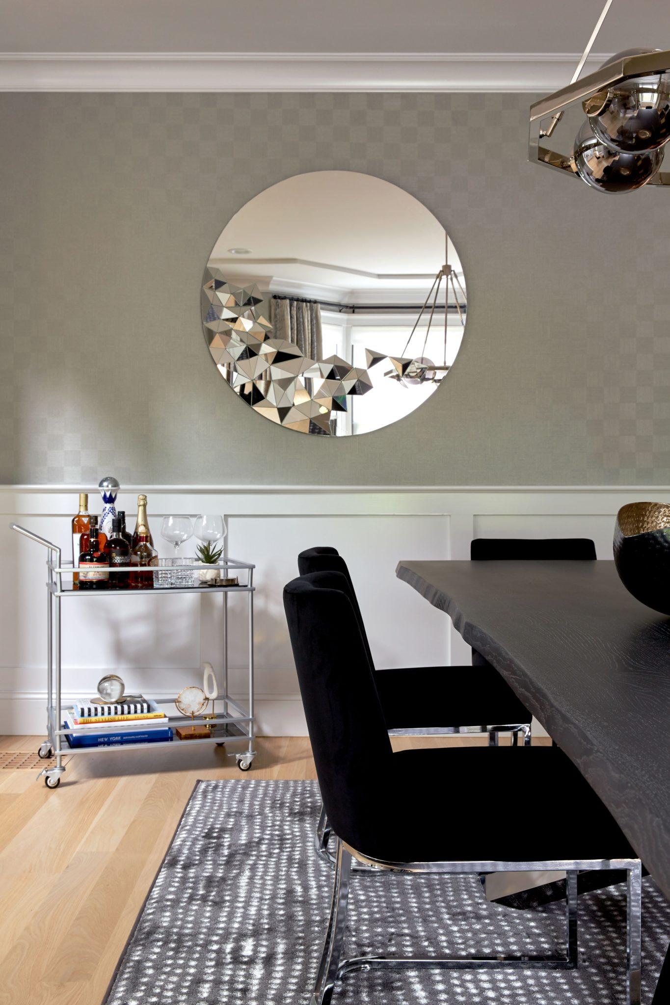 Chic dining room with round mirror by Allison Garcy Interiors