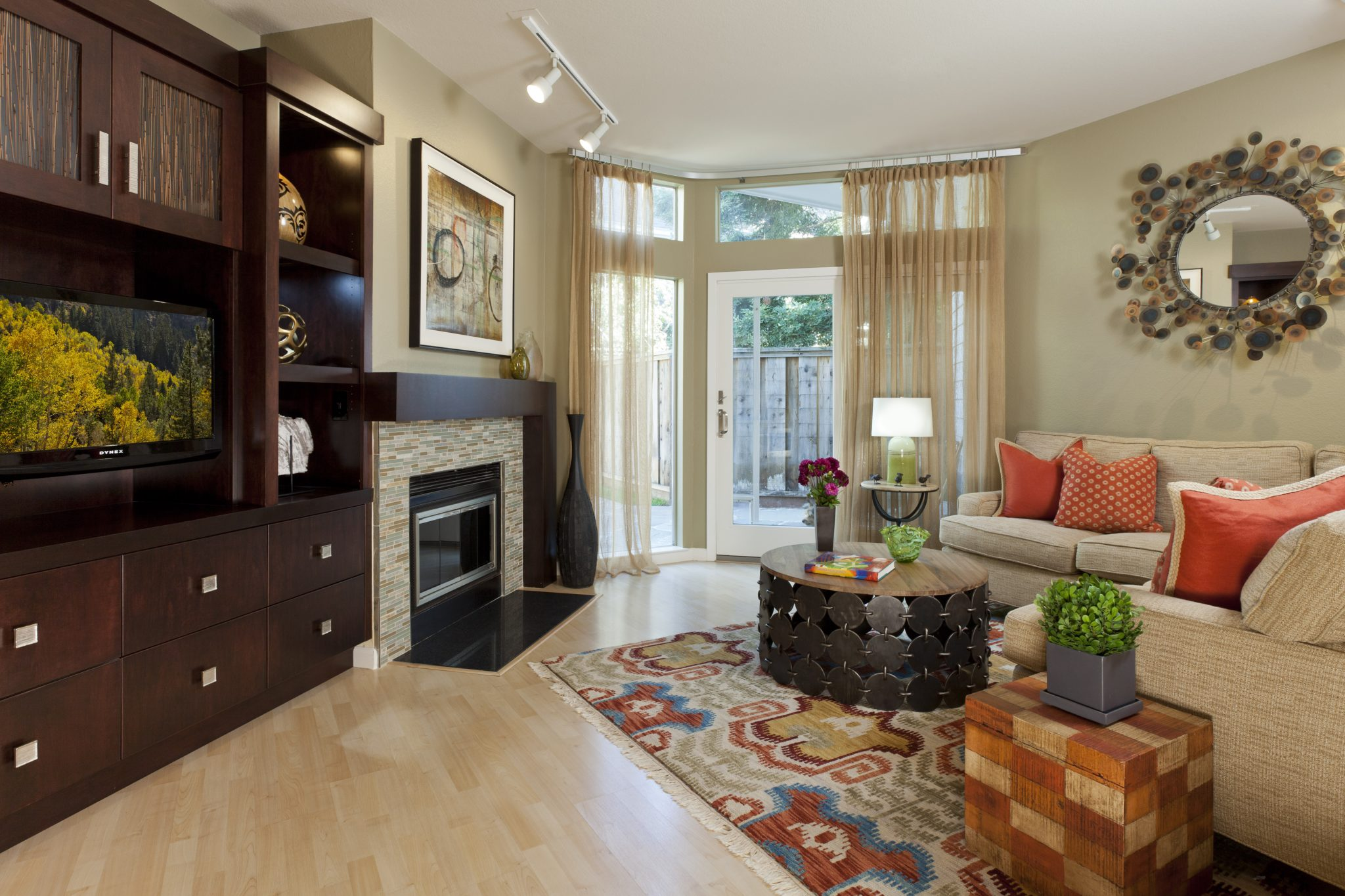 Family room showcases custom built-in and textured upholstery with ikat area rug by Alison Whittaker Design