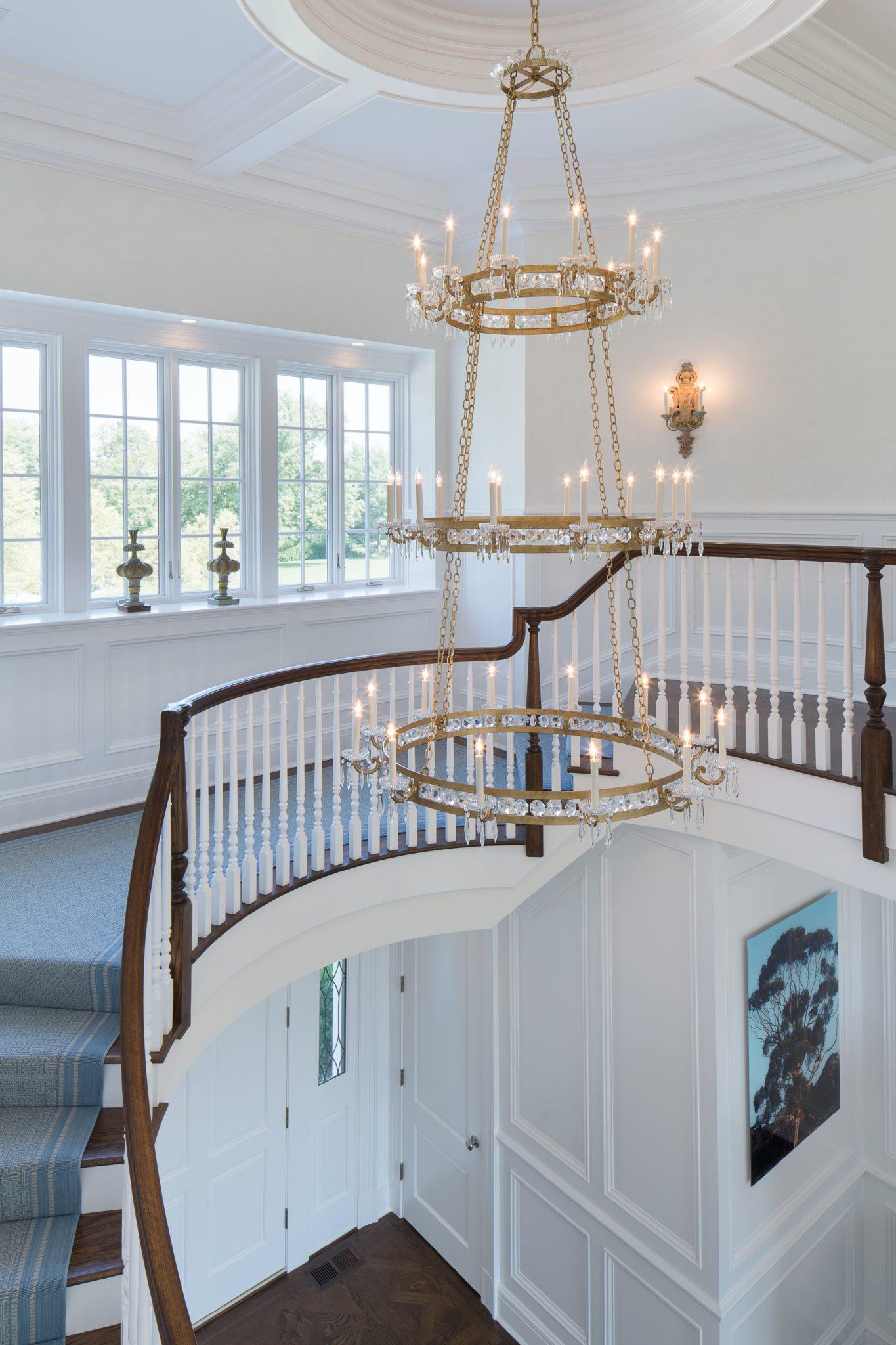 Entry foyer with custom chandeliers by Tyler Tinsworth LLC