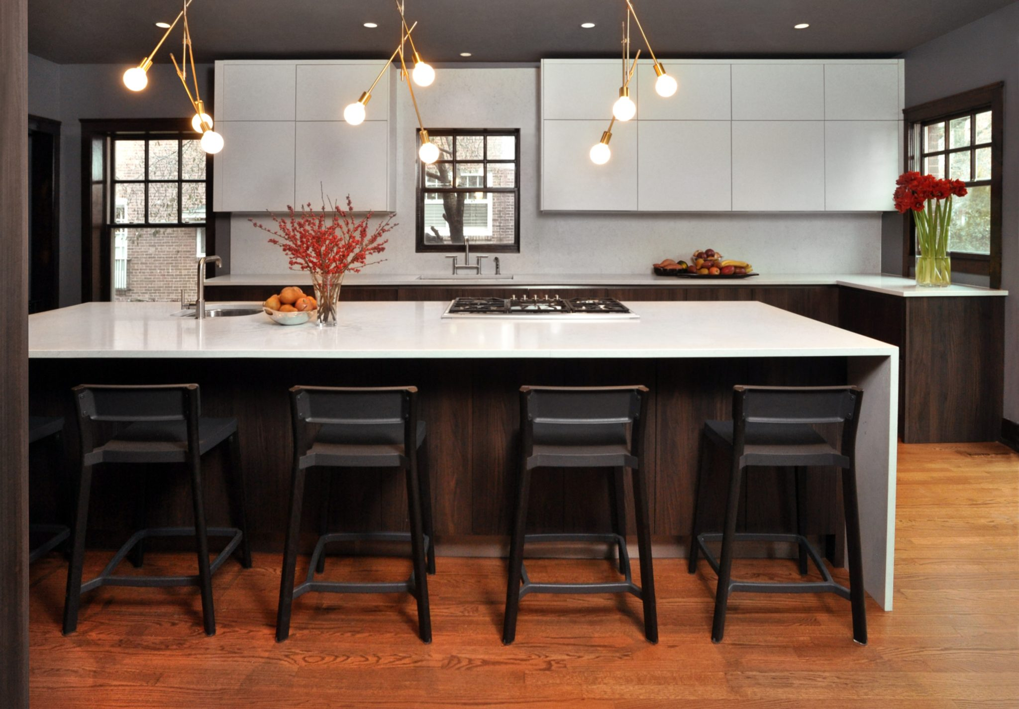 Oak Park kitchen - mid-century modern-inspired chef's kitchen with counter seating by Nicholas Moriarty Interiors