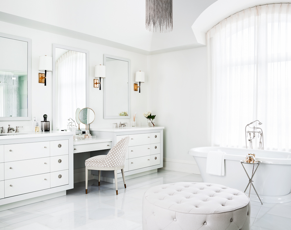 The ensuite master bathroom has a modern sensibility with clean lines, captivating light fixtures and muted hues.