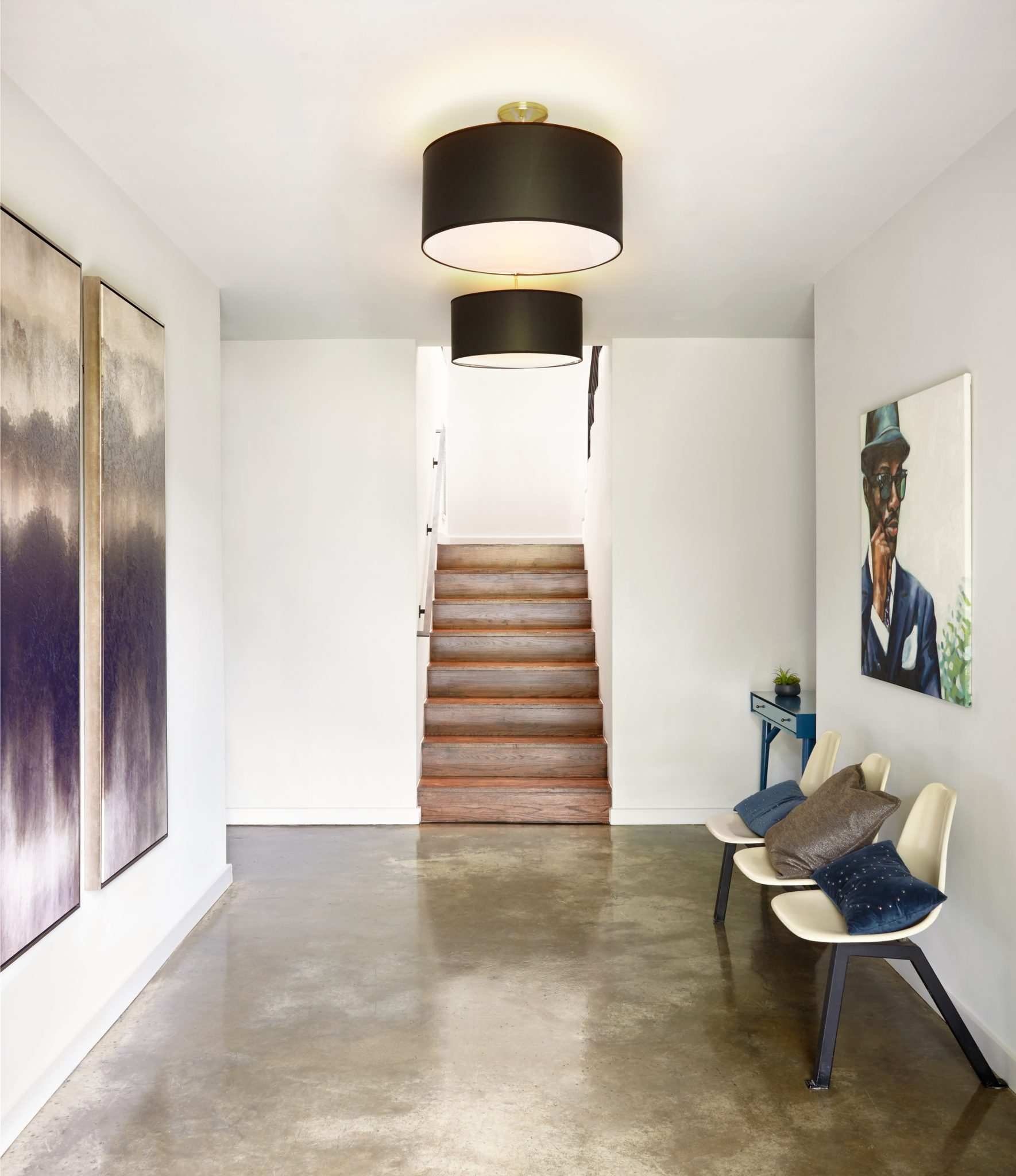 Stained concrete floors with mid-century modern bench seating. By Marcelle Guilbeau Interior Design