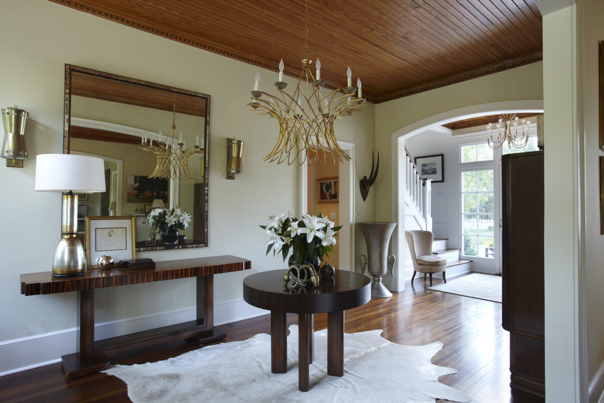 The entrance hall of a converted stable in the Hamptons by Elizabeth Hagins Interior Design