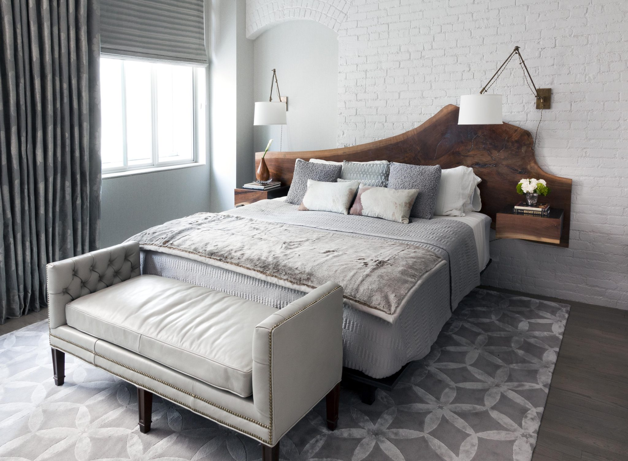 Tribeca Loft Master Bedroom with Live Edge Walnut Headboard by PURVI PADIA DESIGN