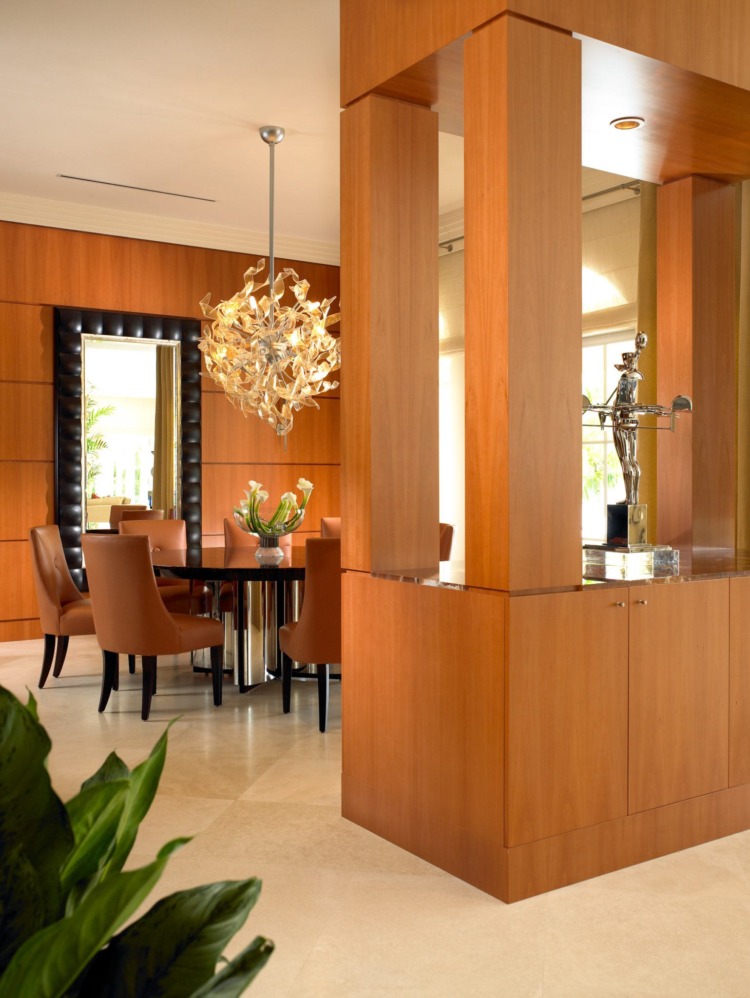 A dining area with pear wood cabinetry and custom full height buffet for storage by Alene Workman Interior Design