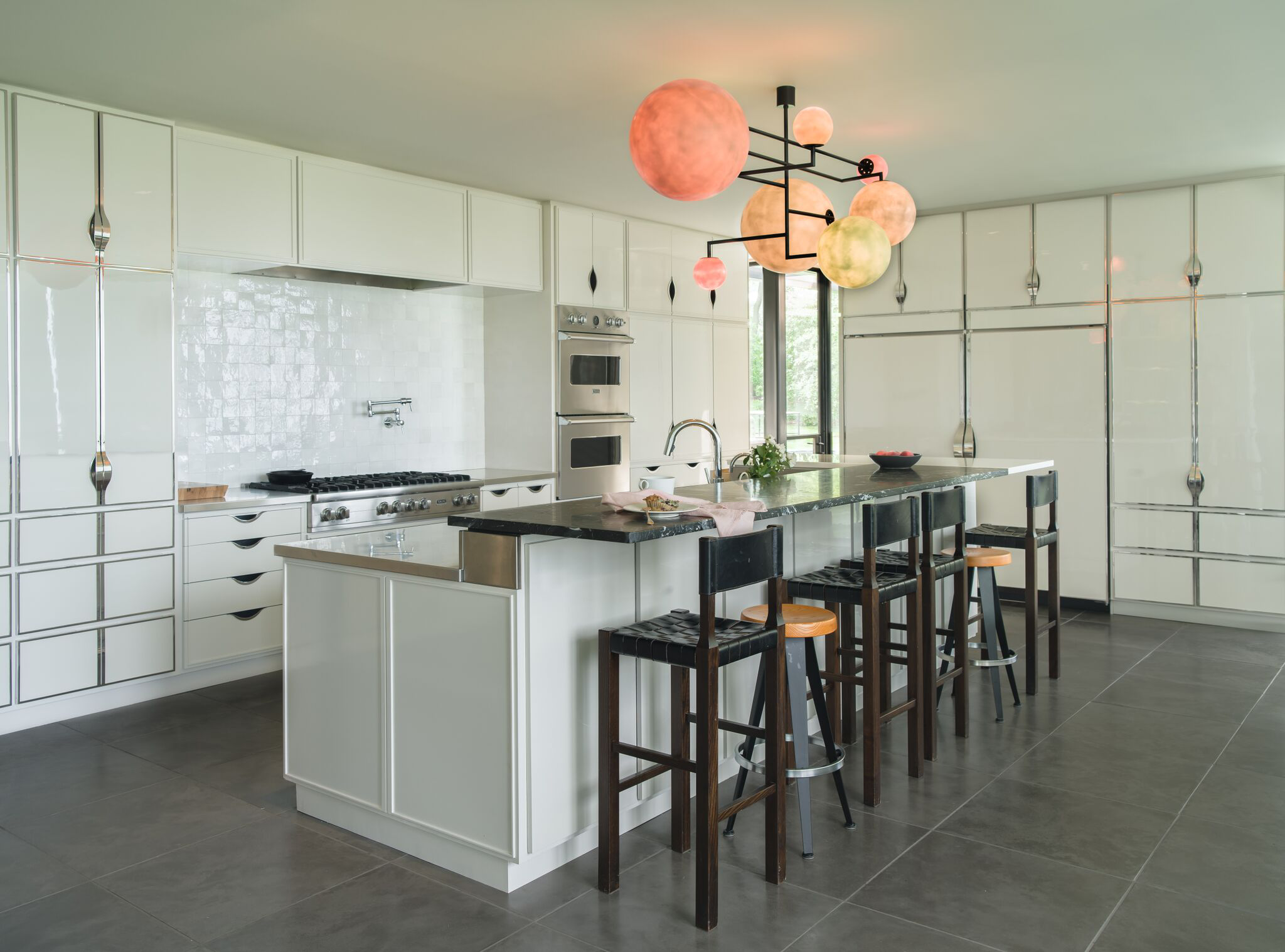 Connecticut chef's kitchen with concrete floor, handmade tiles, and custom hardware by Fine Concepts
