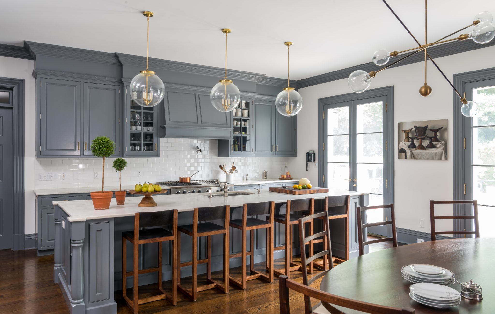 Kitchen with glossy dark grey millwork by S.B. Long Interiors