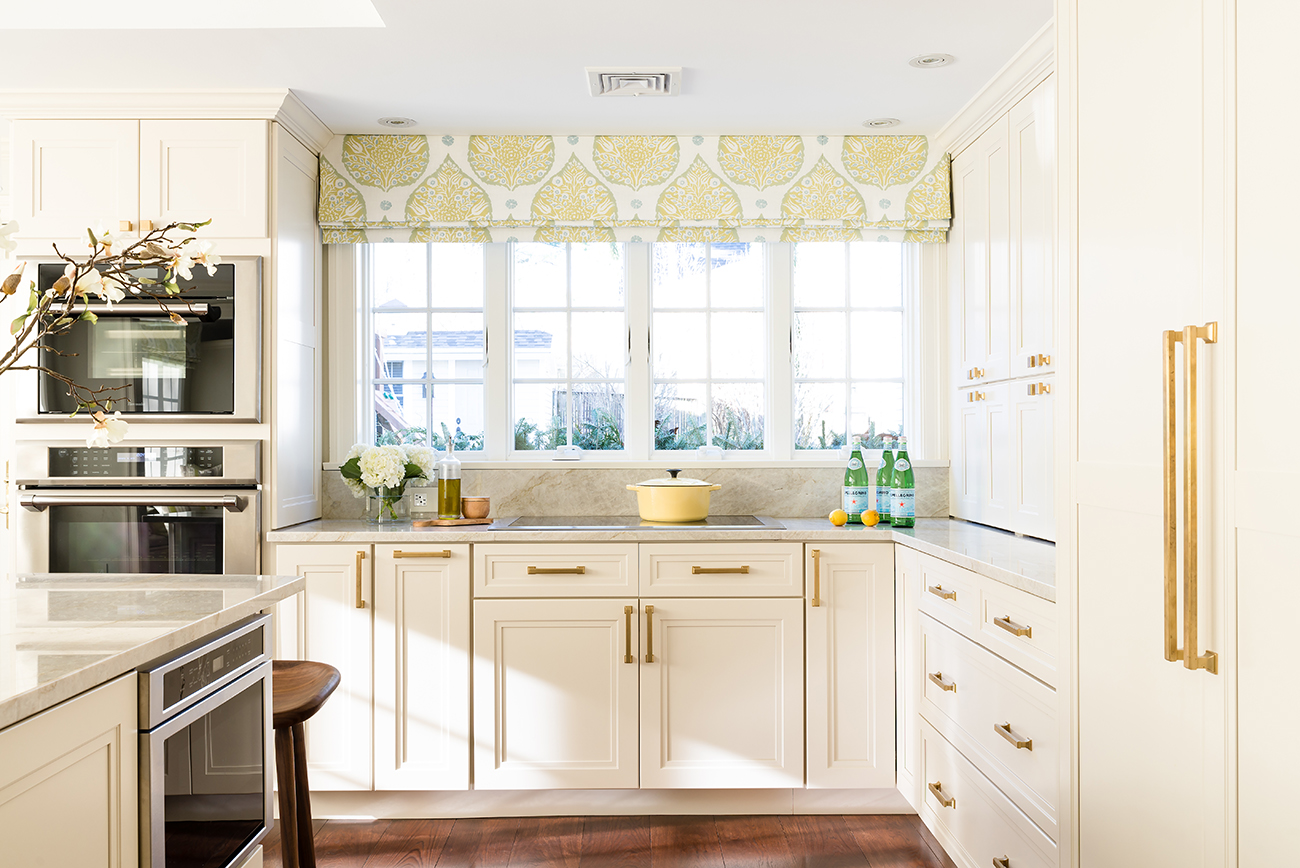 A inviting kitchen with gold hardwareby Justine Sterling Design