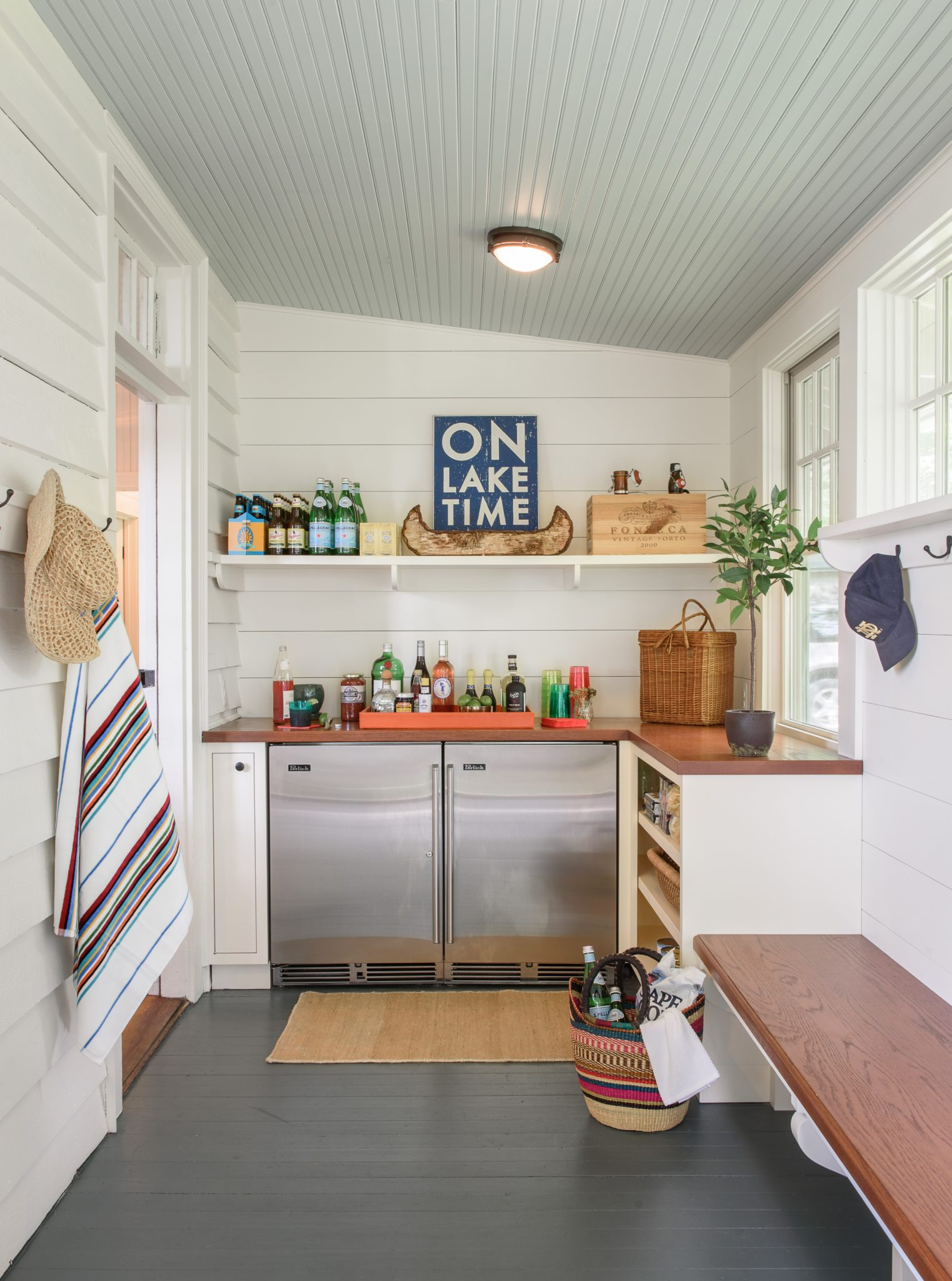 """Lake Michigan Cottage: Converted, enclosed porch becomes """"sand room"""" and bar. by Buccellato Design, LLC"""