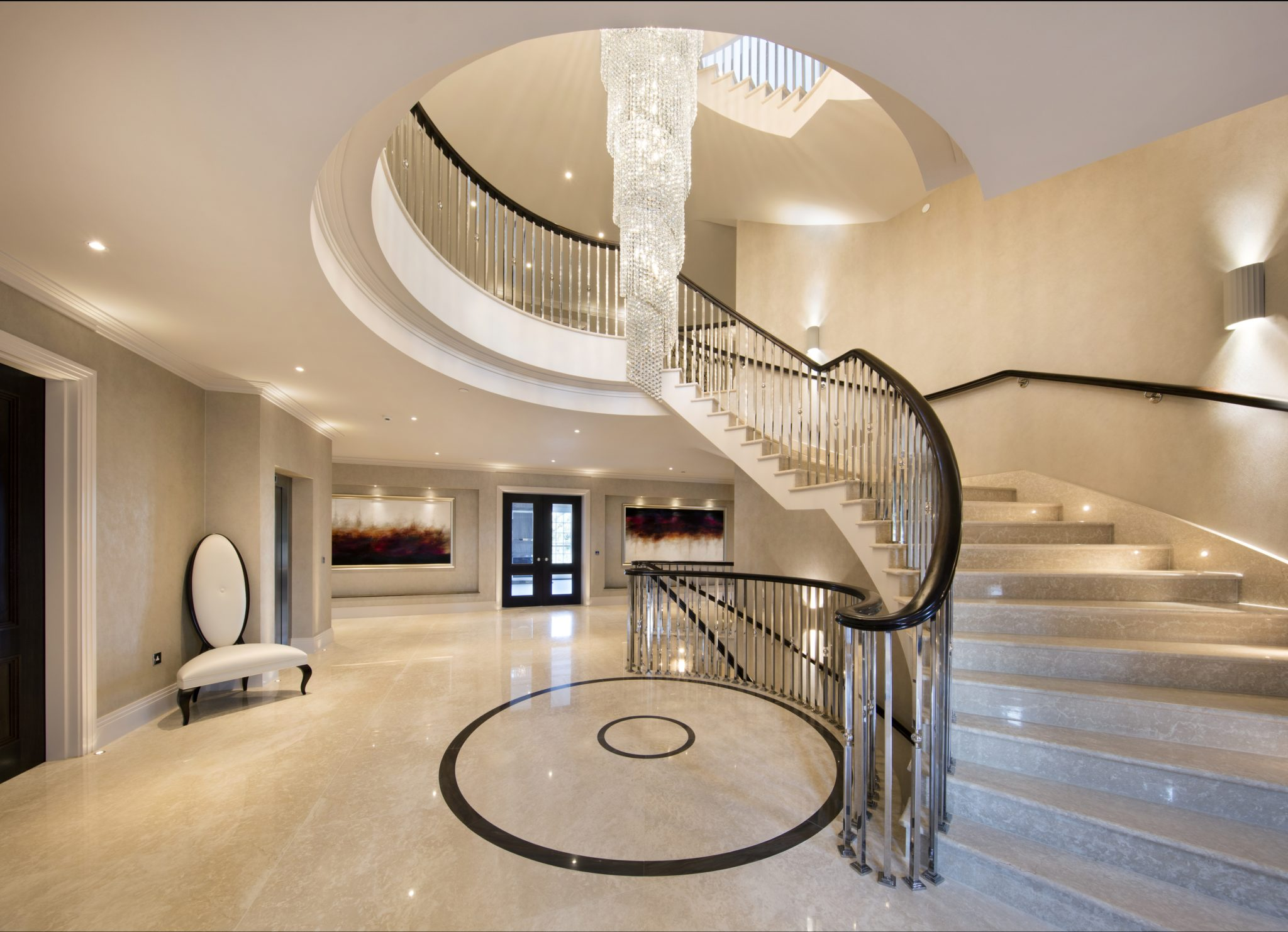 Sweeping staircase, 23,000 sq. ft. private residence, Totteridge, North London. By Interiors by Sarah Ward
