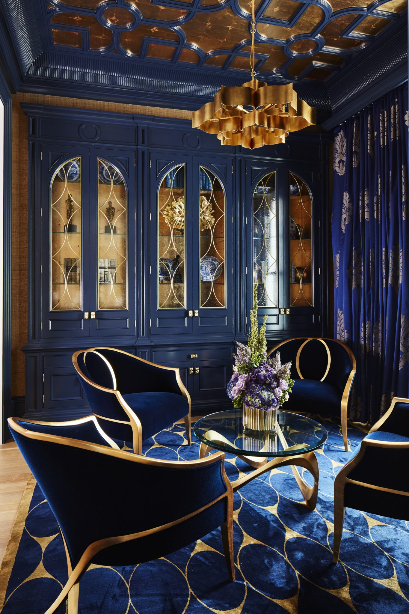 Bold Navy & Gold Parlour, with gold leaf ceiling details, custom cabinets & rug by Alexandra Naranjo Designs