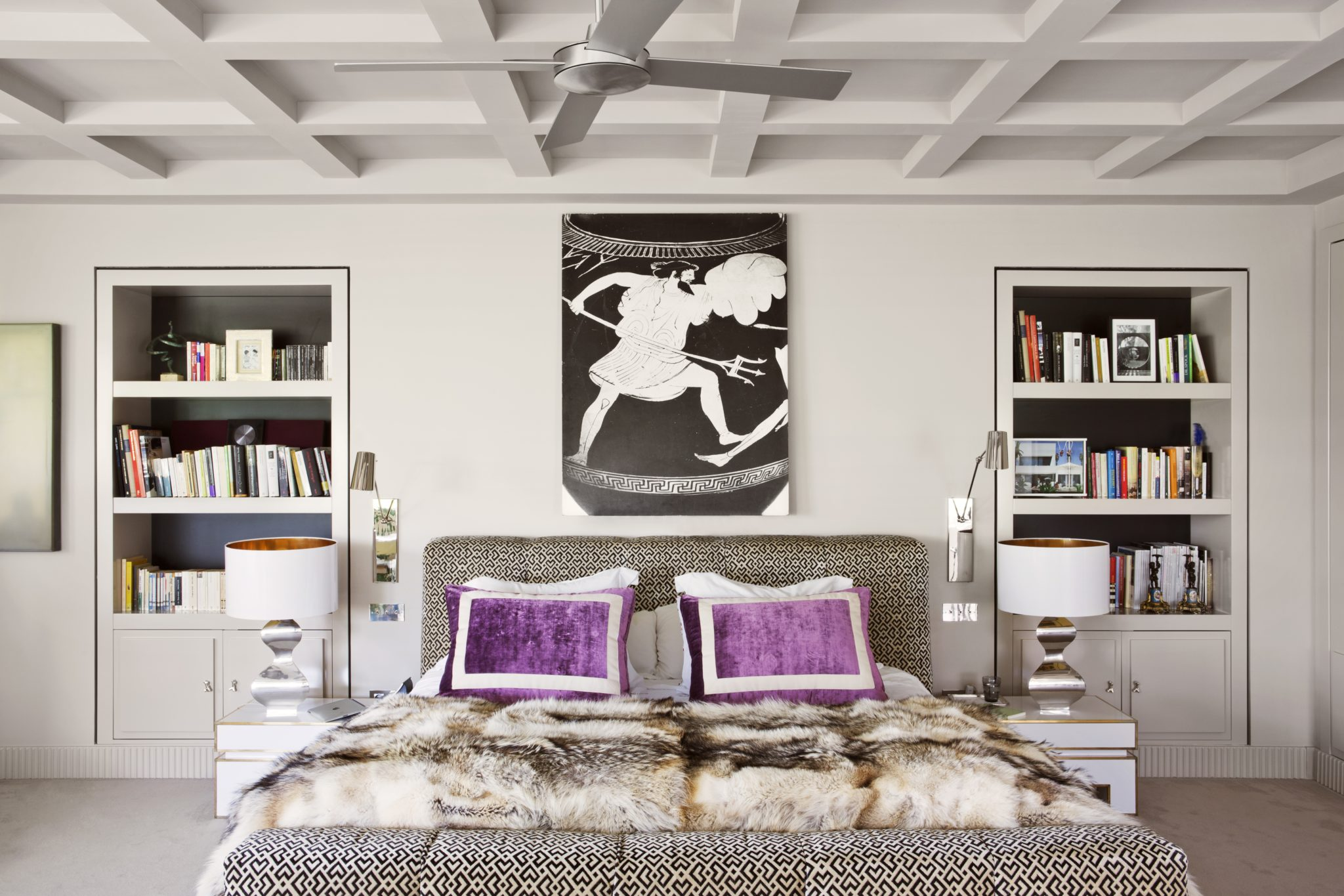 Contemporary bedroom with built-in bookshelves by Lorenzo Castillo