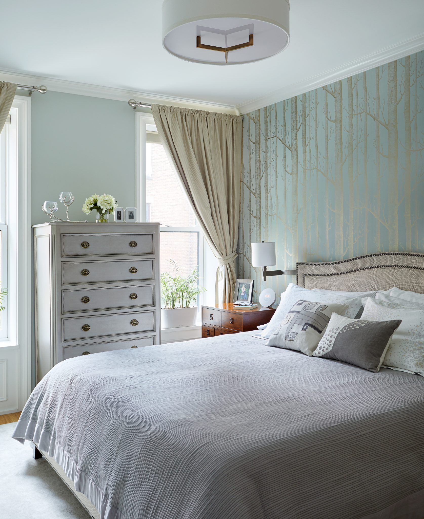 Master Bedroom in Neutral Tones with Woods Wallpaper Accent by Silverwing Interiors