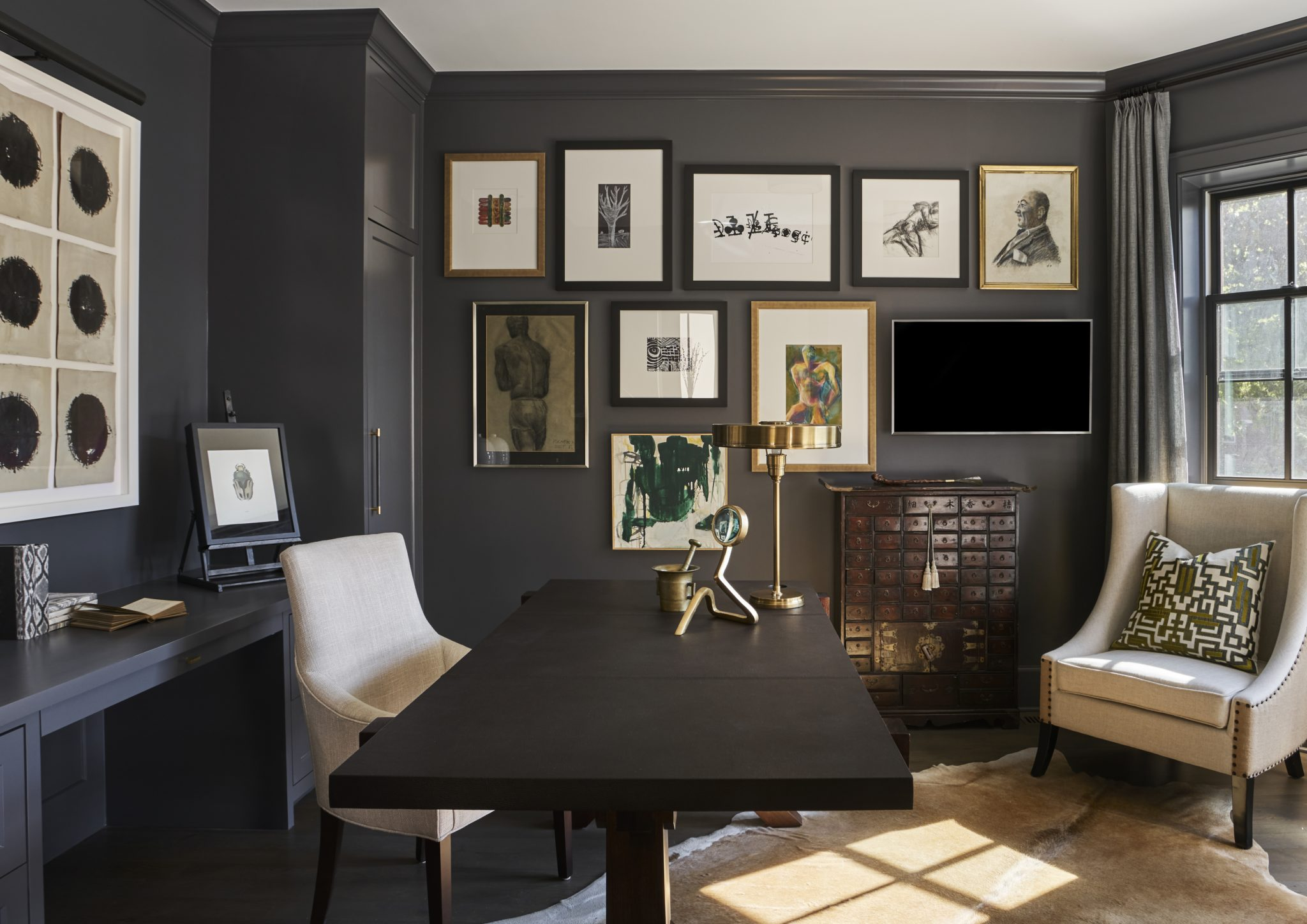 Ukrainian Village townhouse study with dark features and an eye-catching gallery by Elizabeth Krueger Design