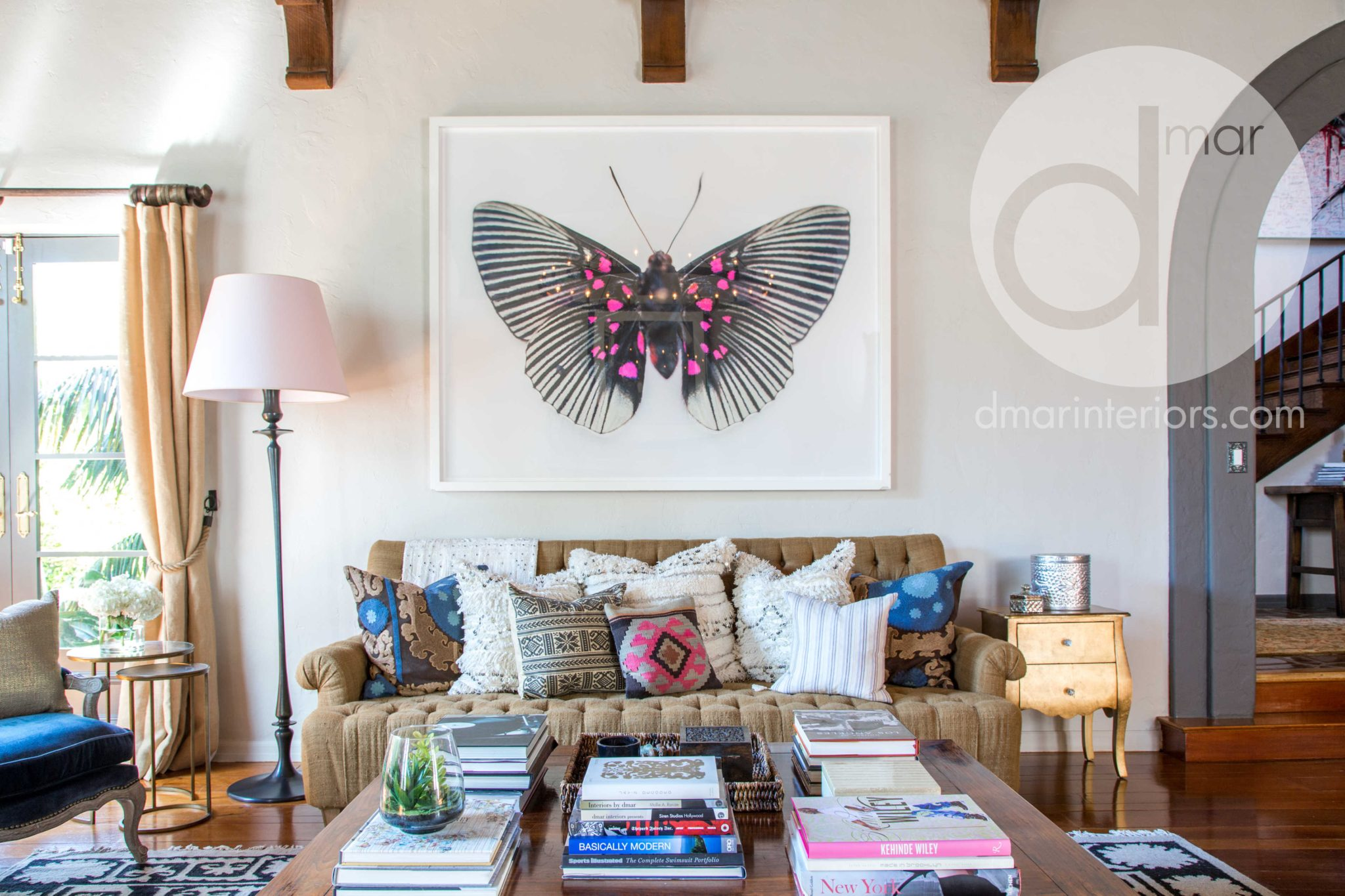 Spanish Boho estate with large art and wood beams by dmar Interiors