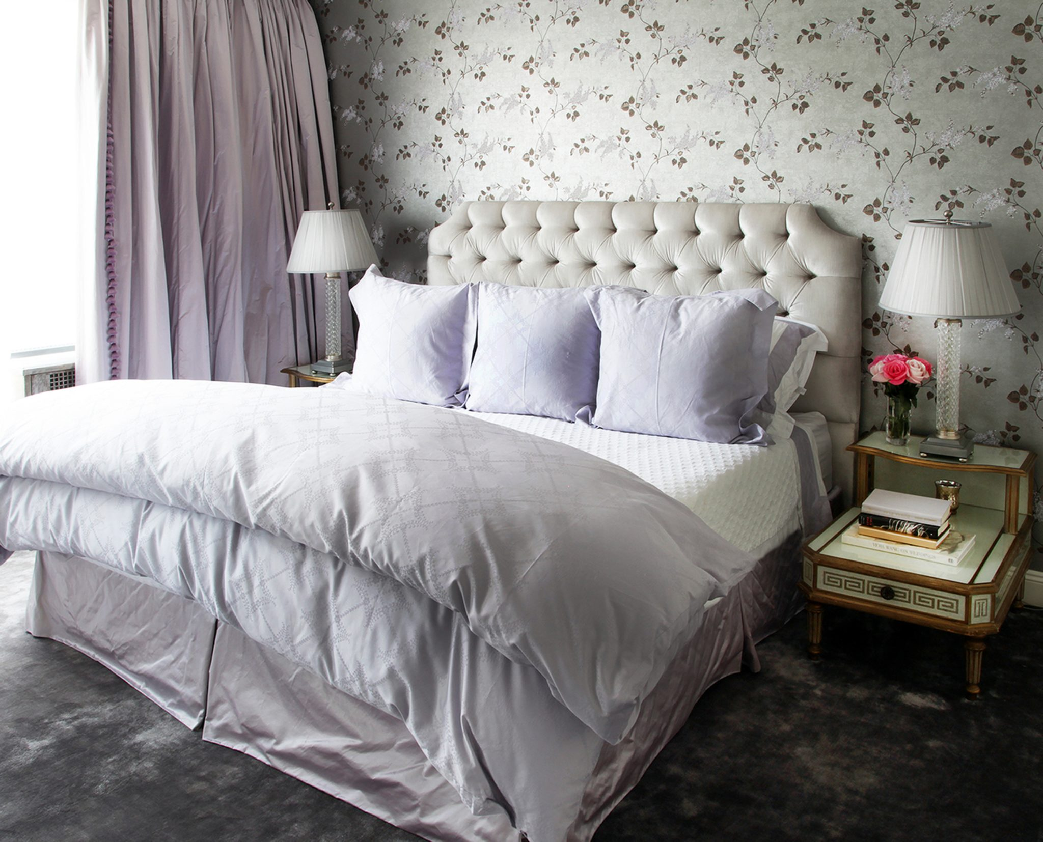 Traditional master bedroom with floral wallpaper, tufted headboard by Greg McKenzie Designs