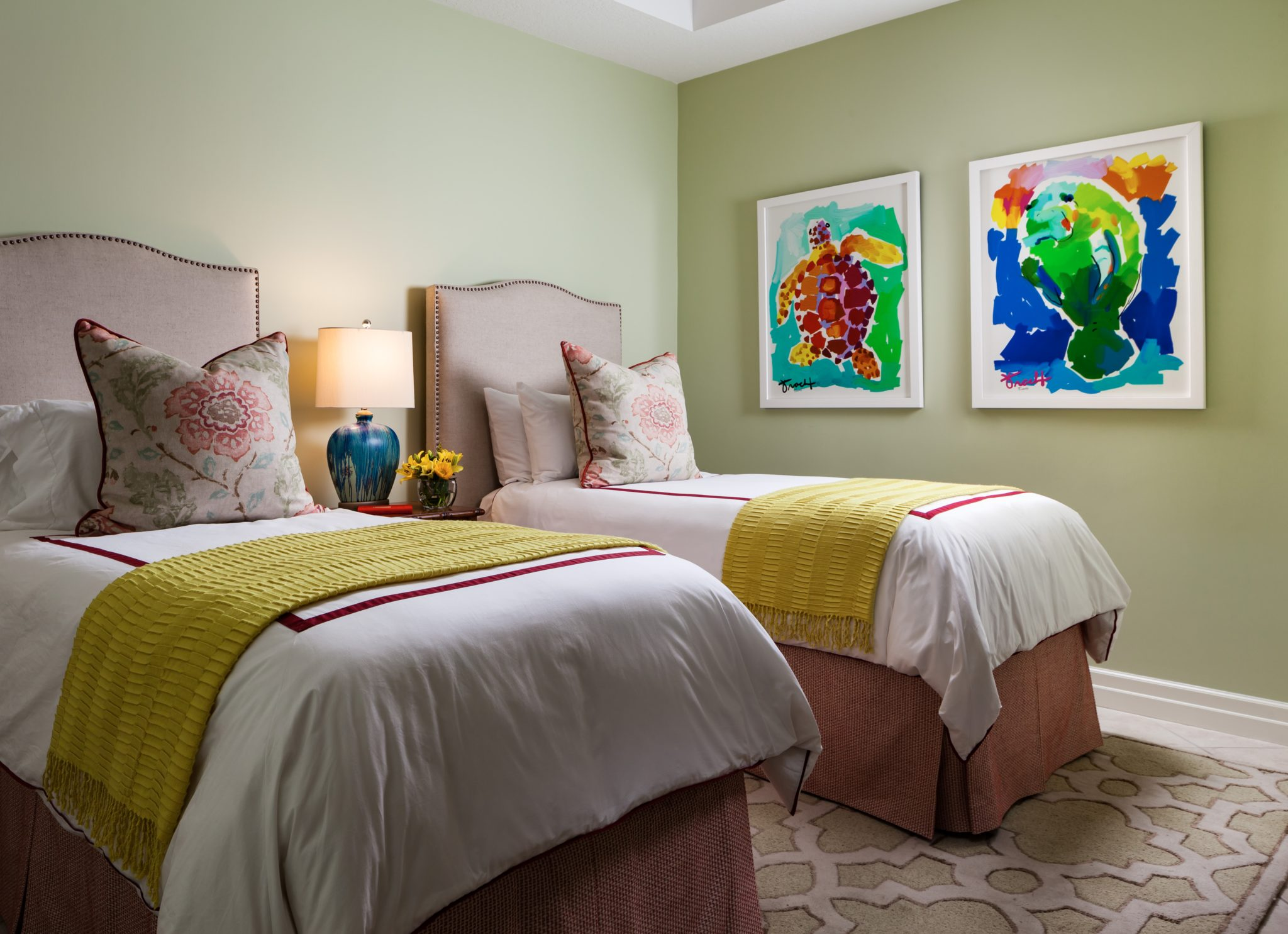 This beautiful bedroom is both playful and comfortable. by Gil Walsh Interiors