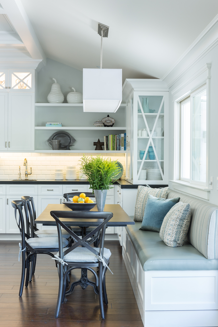 Custom banquette seating in kitchen by Gilmore Design Studio