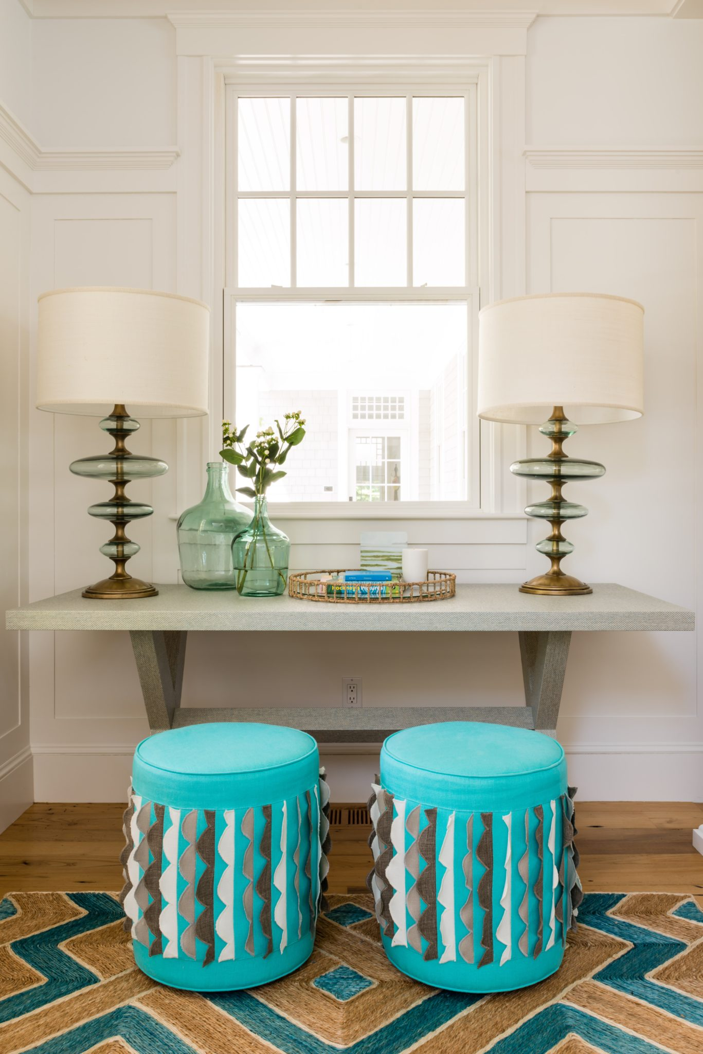 Osterville Coastal House - Entry Hall Console and Ottomans by Justine Sterling Design