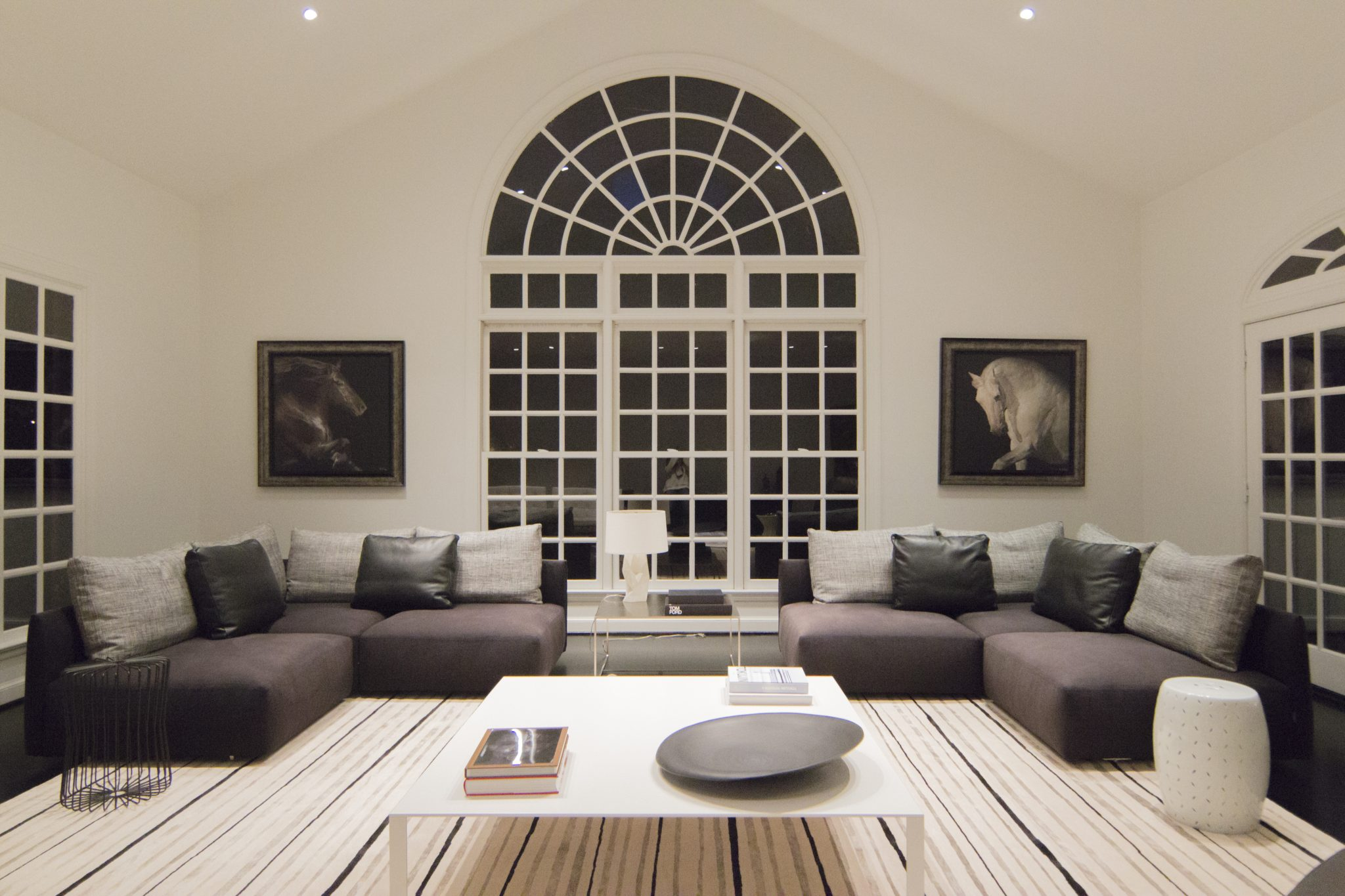 An inviting family room with ample seating by Mow Design Studio