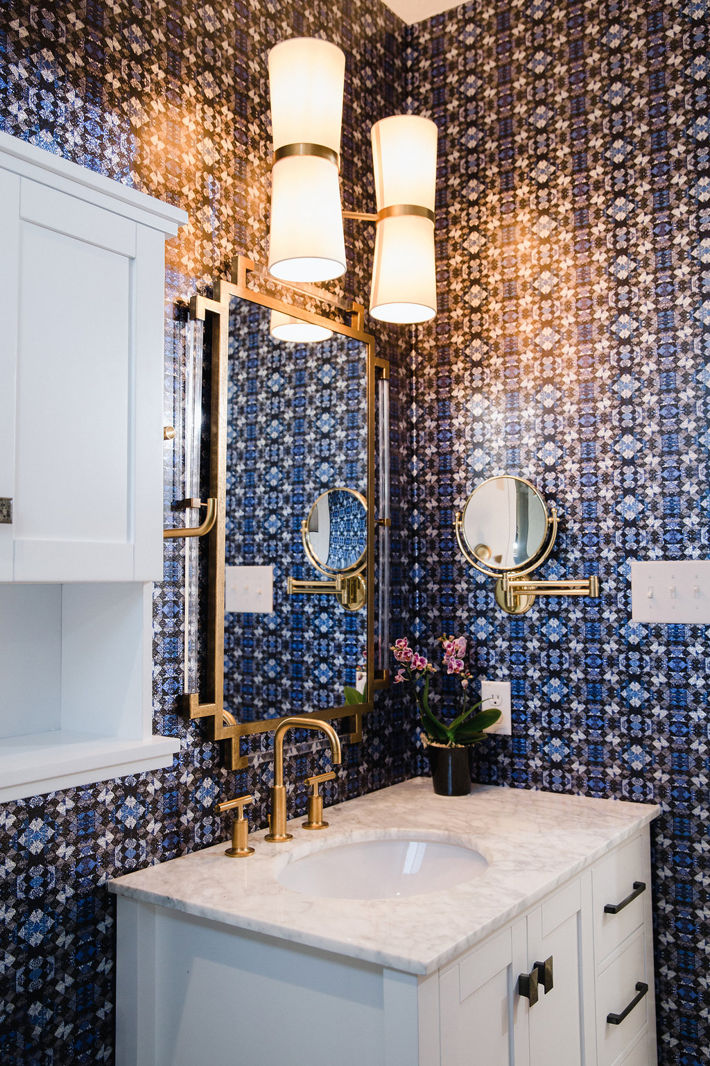 Brass Faucet and Geometric Wallpaper in this Glamorous Bathroom by Maureen Stevens Design