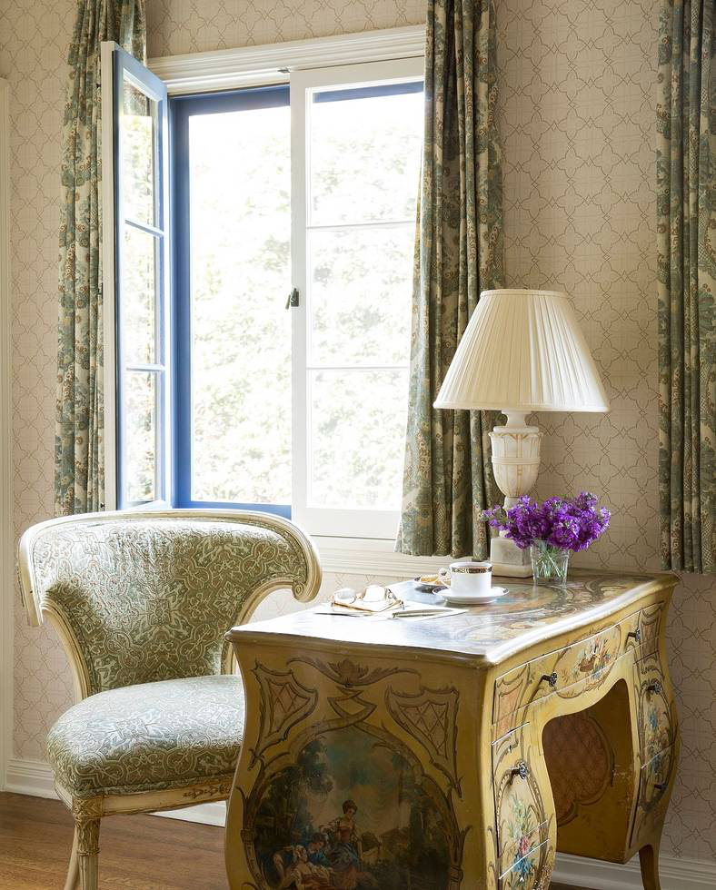 This is the sitting room, off the master bedroom. The walls have been covered in Classic Cloth's Limoges, and the curtains are in Enchantment by Waverly. The small painted writing desk is vintage Italian.