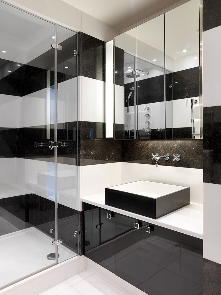 Art Deco-inspired bathroom in white marble and black granite by Key Interiors