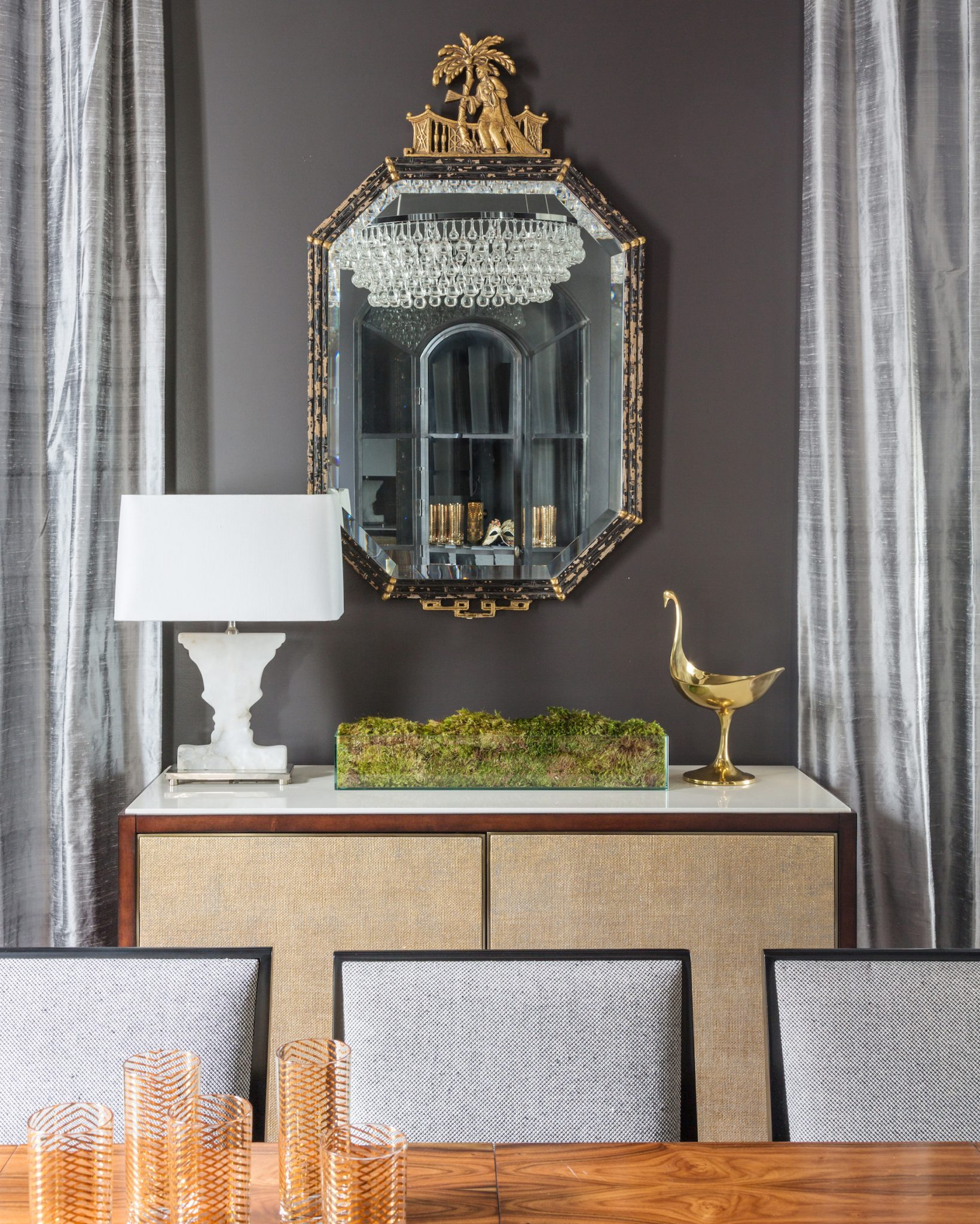 Dining Room detail of stone top server and antique chinoiserie mirror by Eclectic Home