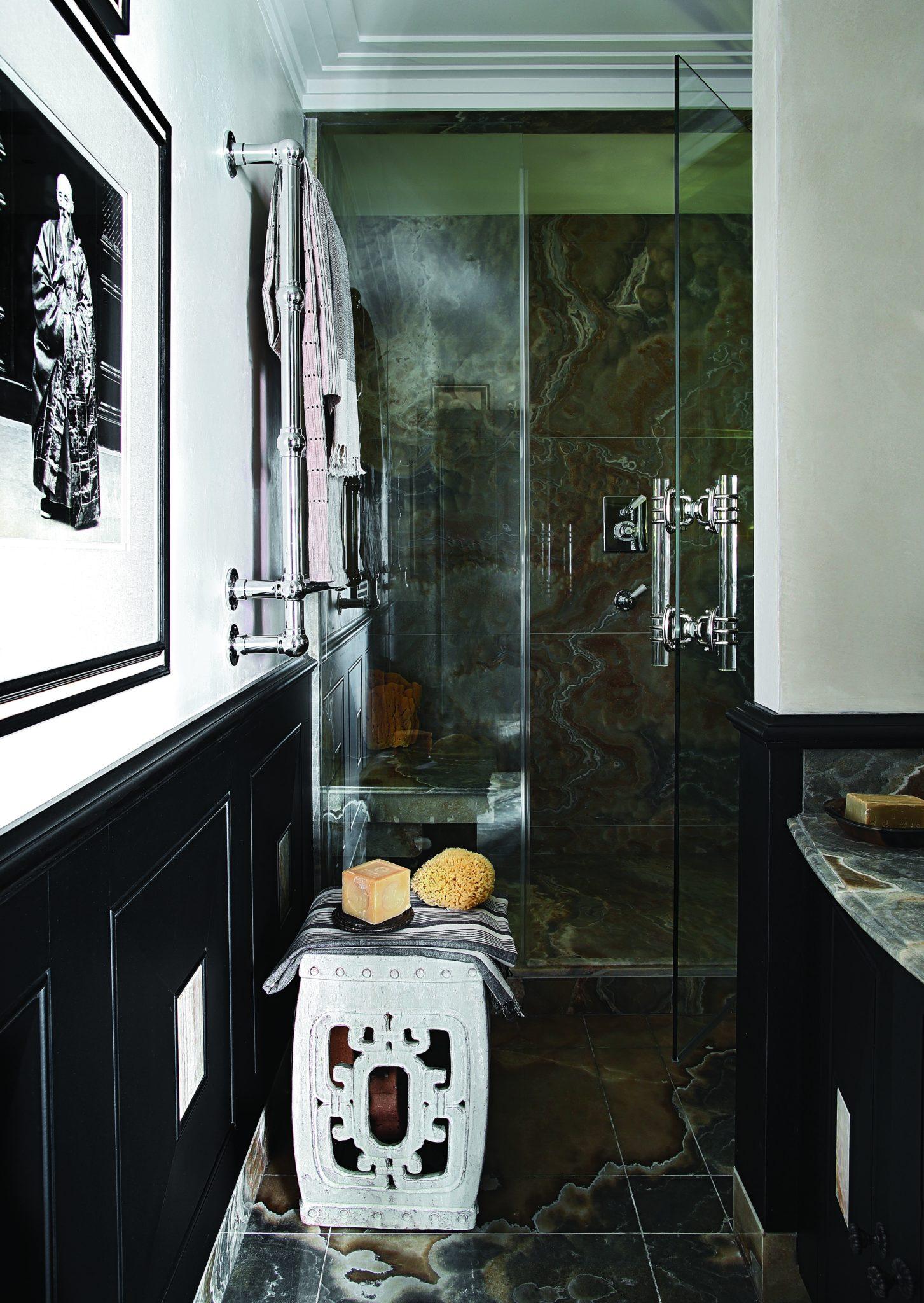 Sleek Chelsea bathroom with dramatic marble surfaces by Hubert Zandberg Interiors