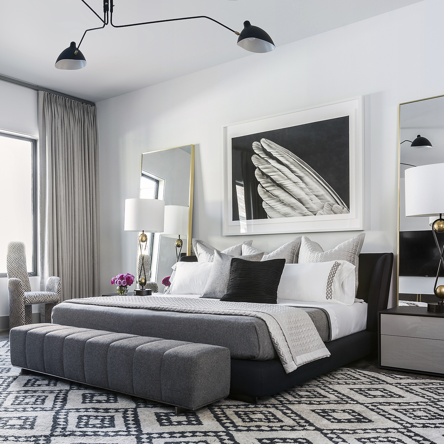 Black and white graphic bedroom with custom linens and contemporary art by Benjamin Johnston Design