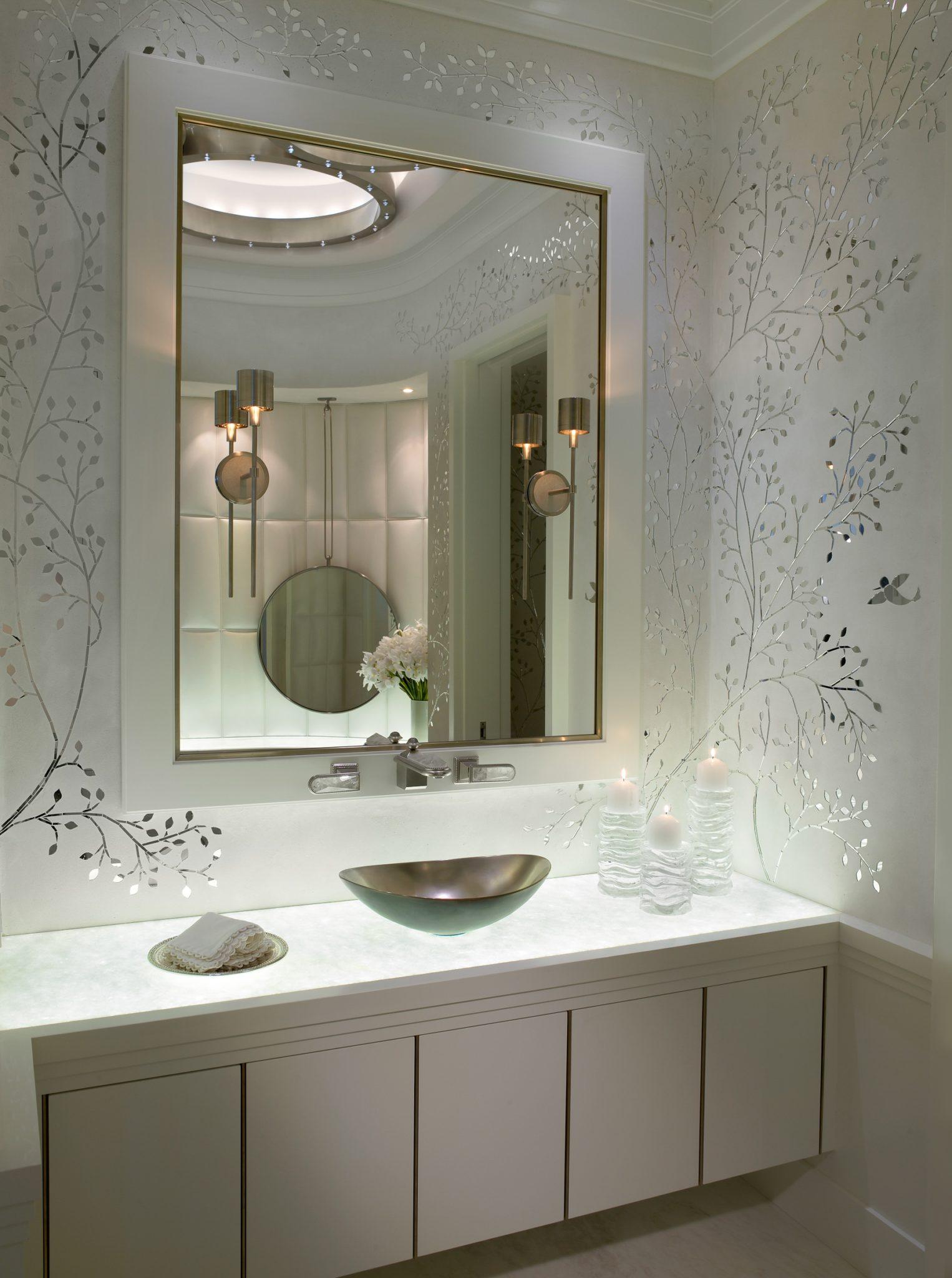 Delicately branching metallic wallpaper adds shine to this modern powder room. by Alene Workman Interior Design