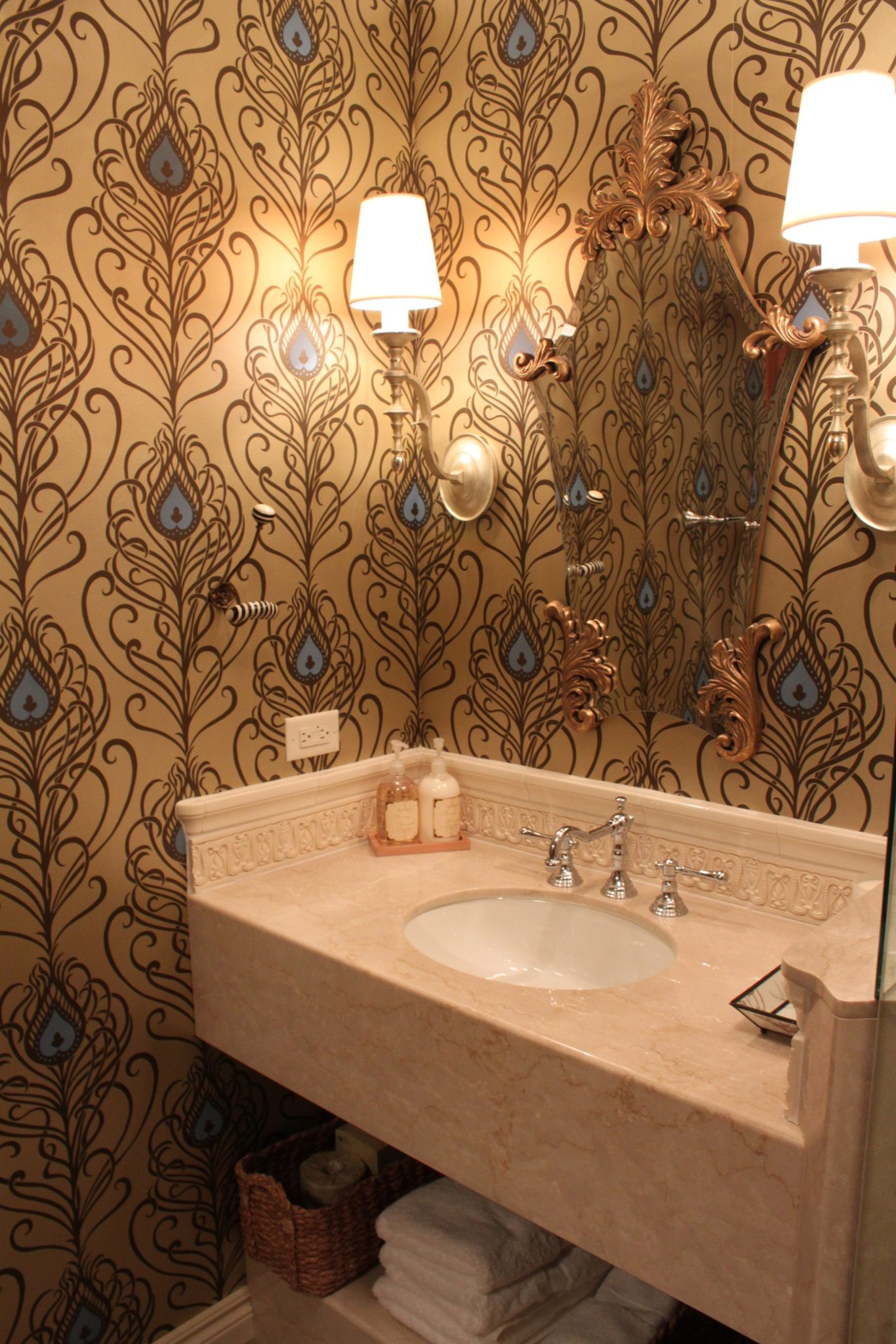 Guest bath with bold wallpaper and unique mirror by Lisa Wolfe Design