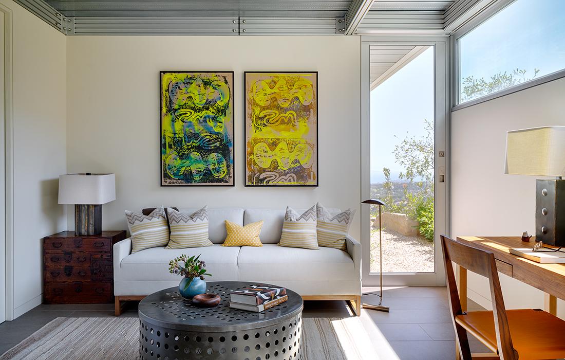 Den with a diptych and desk by Sarah Walker Design Associates