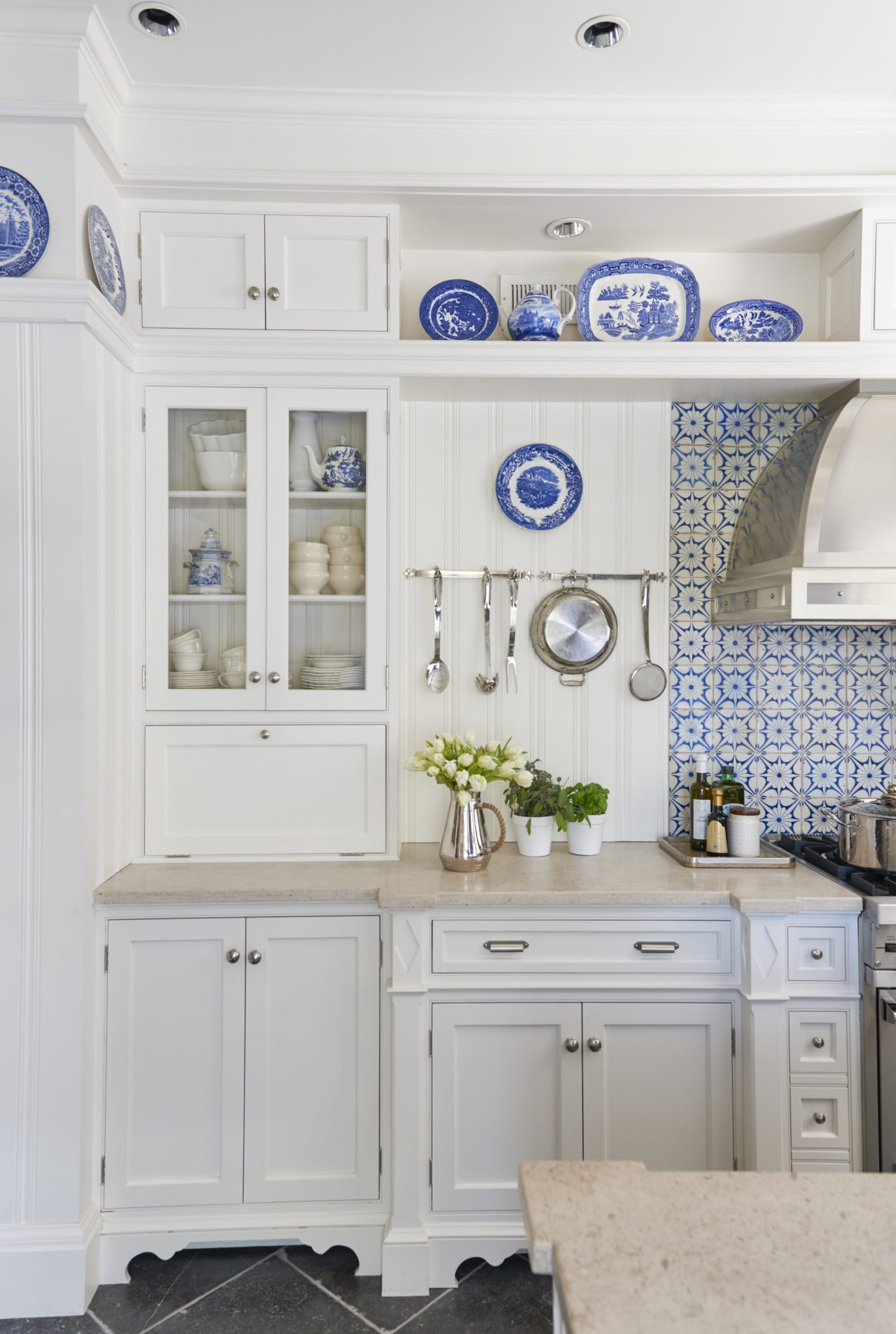 My client's kitchen satisfies her storage needs and cooking capabilities. By Sarah Blank Design Studio