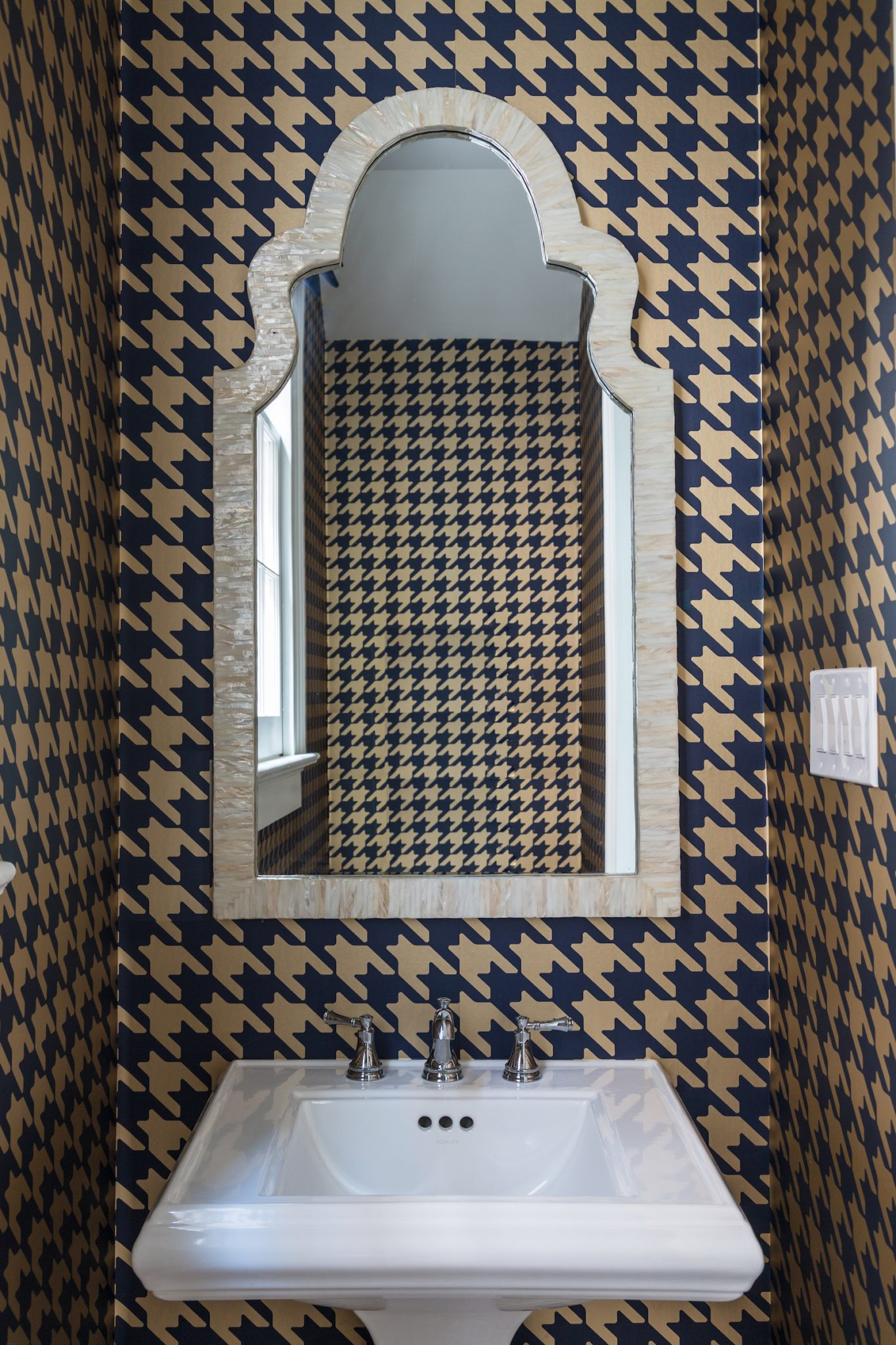 Uptown New Orleans powder room in vinyl houndstooth wallpaper, gold and blue by Eclectic Home