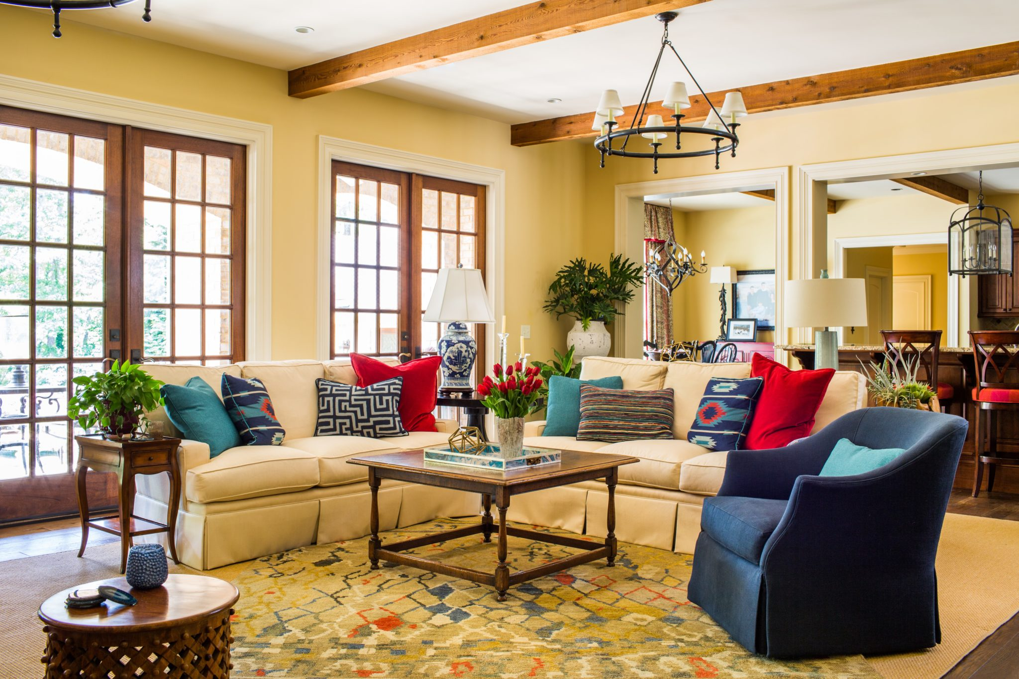 Great room with a play of solids and southwestern prints by Meriwether Design Group