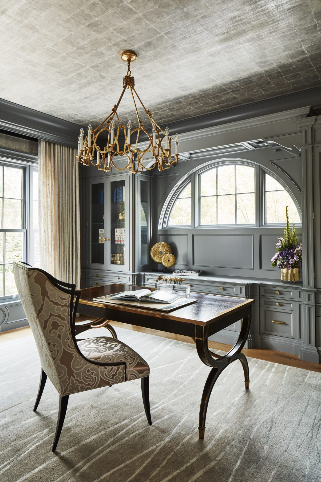 This timeless home office features silver leaf ceilings, custom cabinets. by Alexandra Naranjo Designs