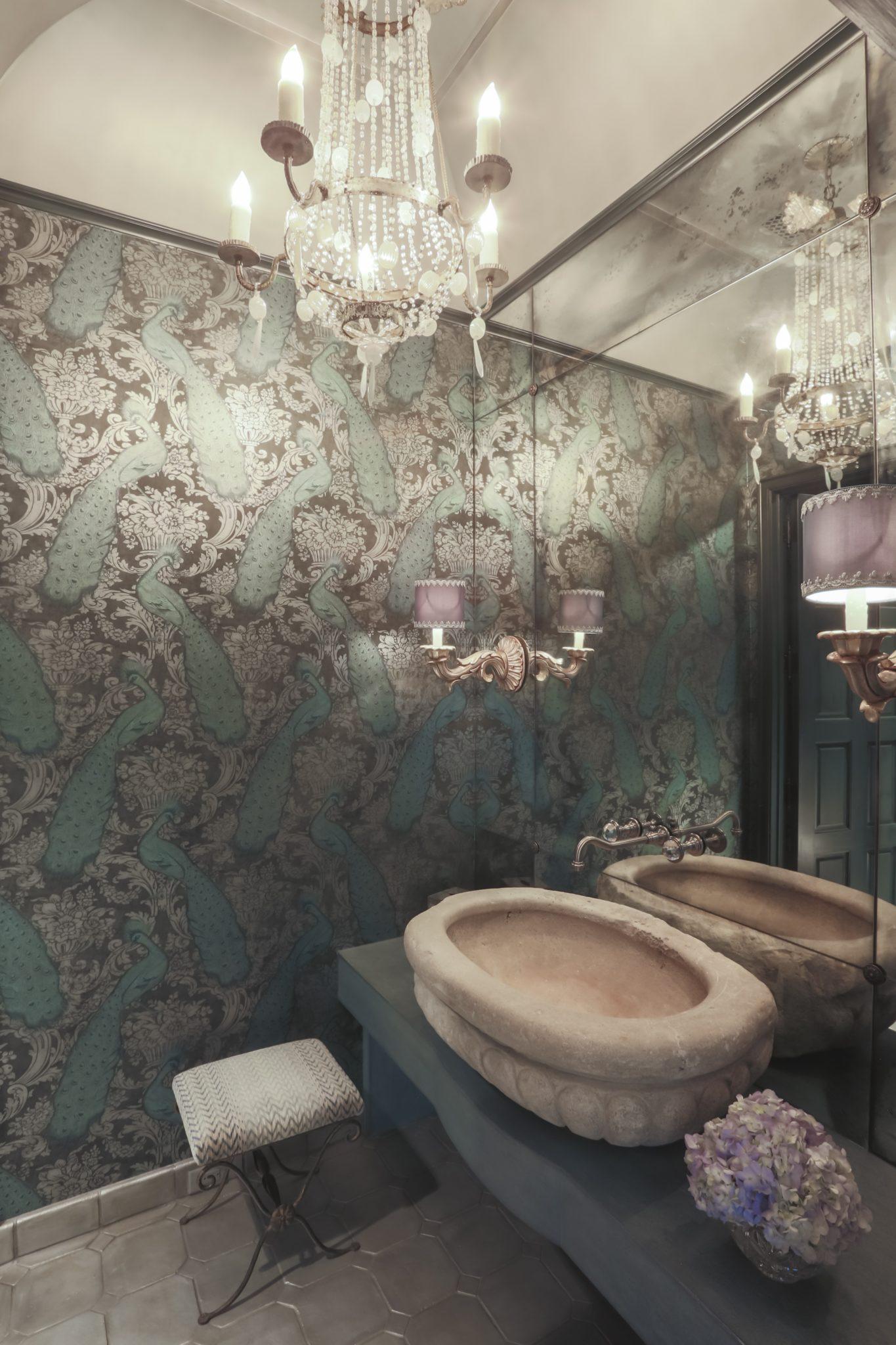 Formal powder- reclaimed stone sink, metallic wallpaper & antique mirrored wall by Nicole Zarr & Associates