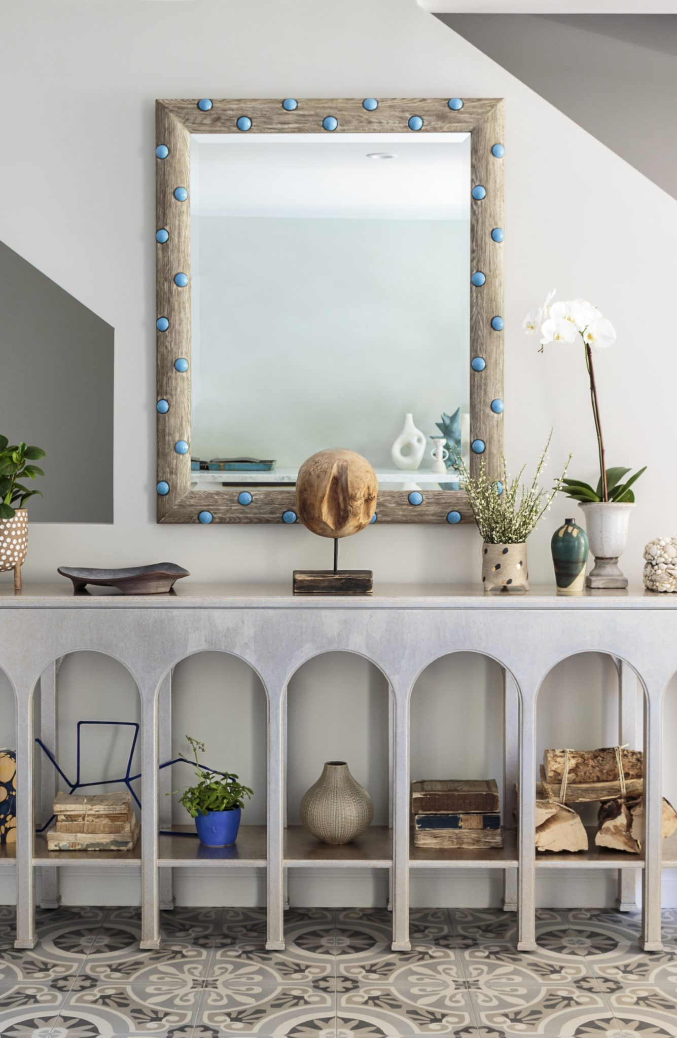 Polka dot mirror and arches make a statement in this entry by Bronwyn Poole by Touch Interiors