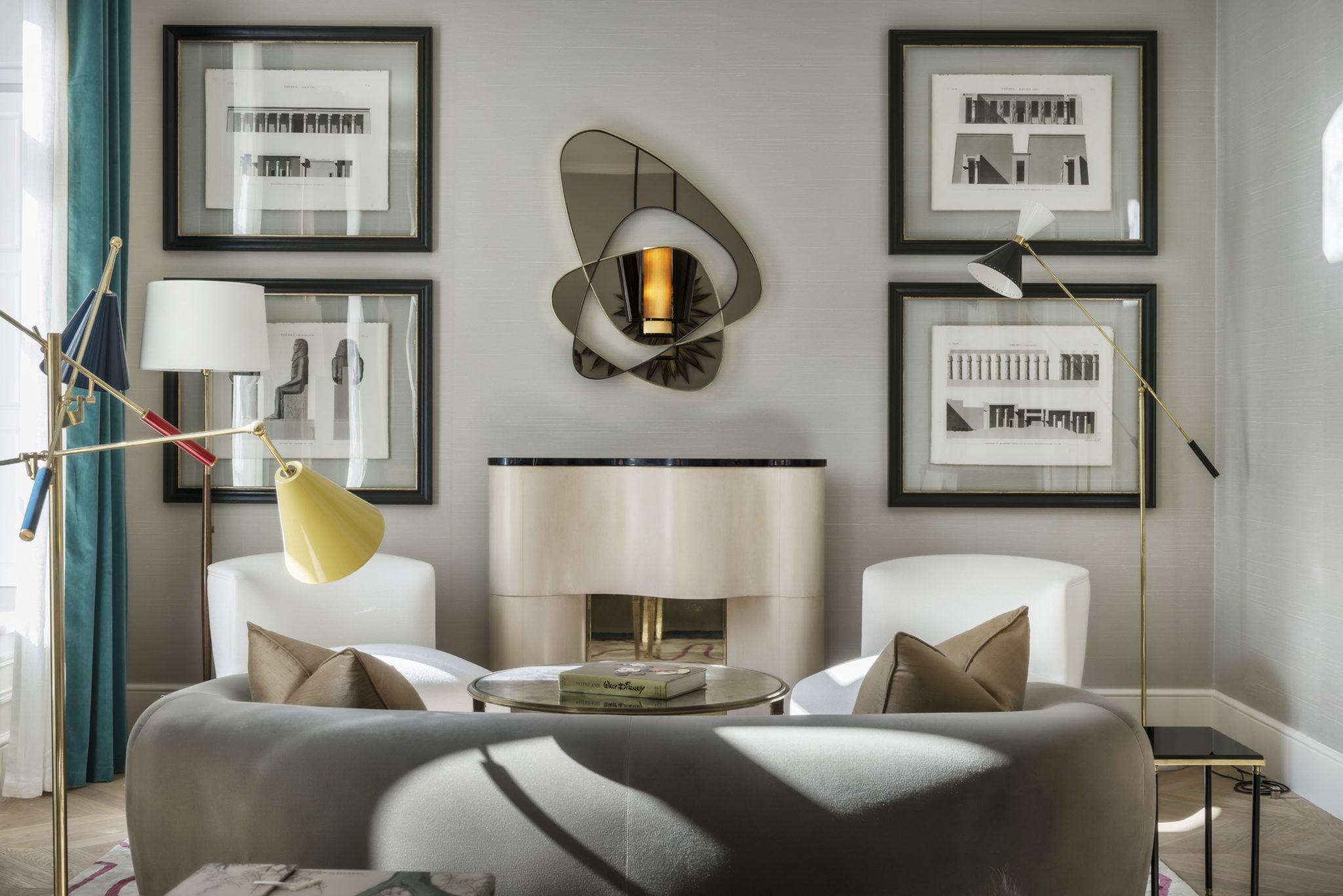 Paris living room with custom fireplace, sofa, chairs, and mirror by Salvagni by Achille Salvagni Architetti