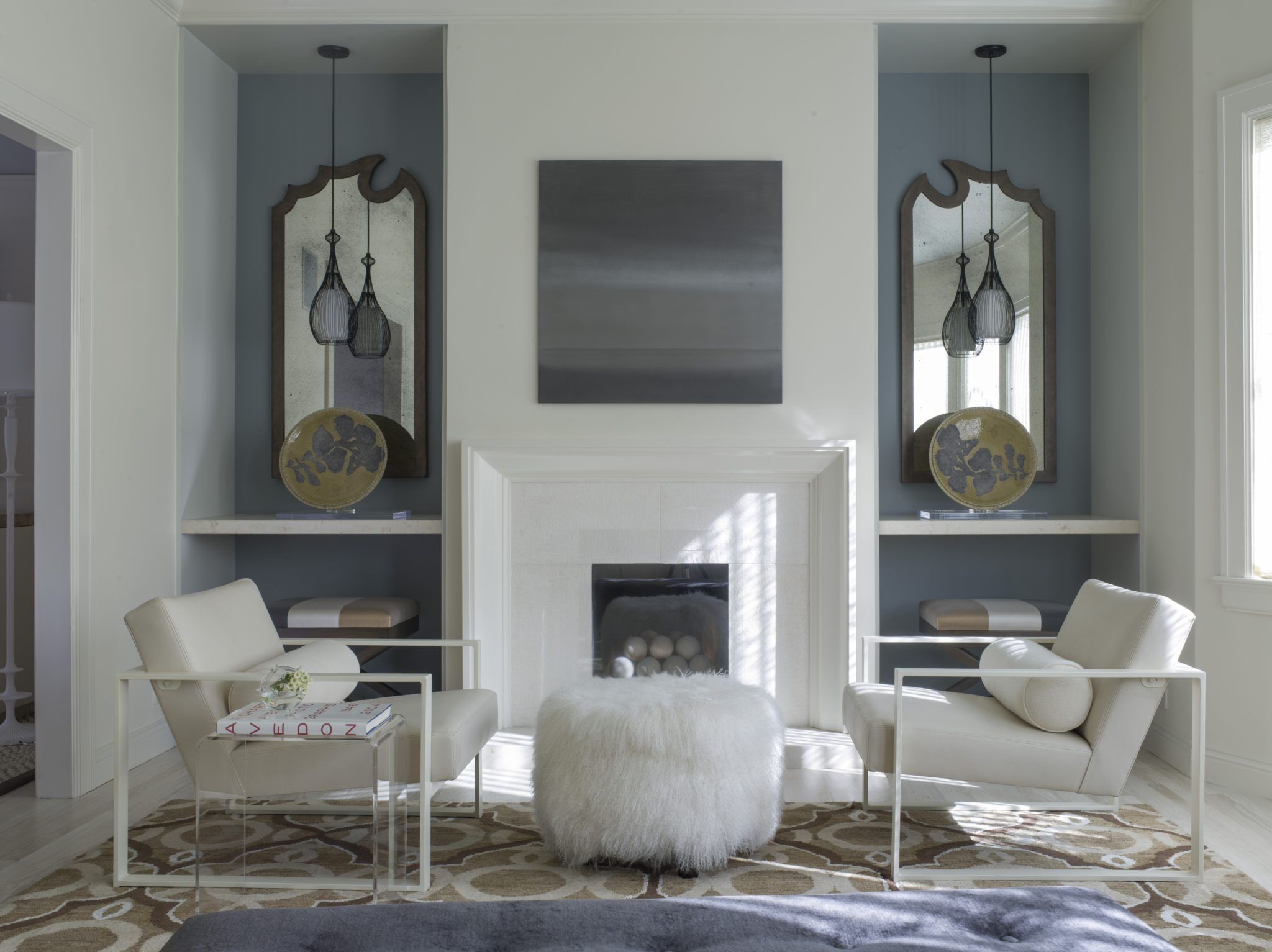 Hand-forged mirrors by Bradley Hughes, CB2 chairs upholstered in bespoke fabric. by Angela Free Design